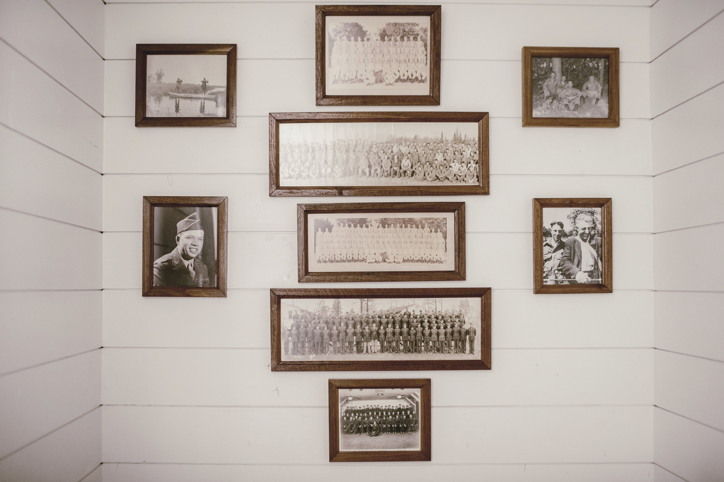 gallery wall of old family photos