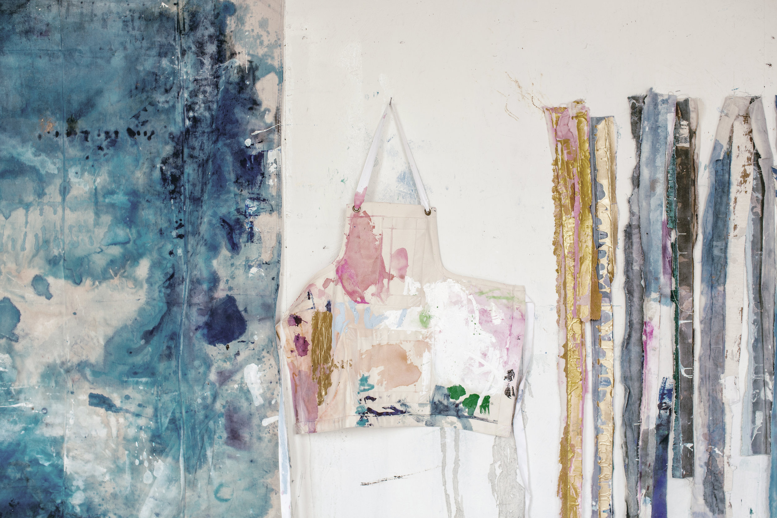 """Kiki's Studio Apron, shown here in her """"painterly haven of controlled chaos."""""""
