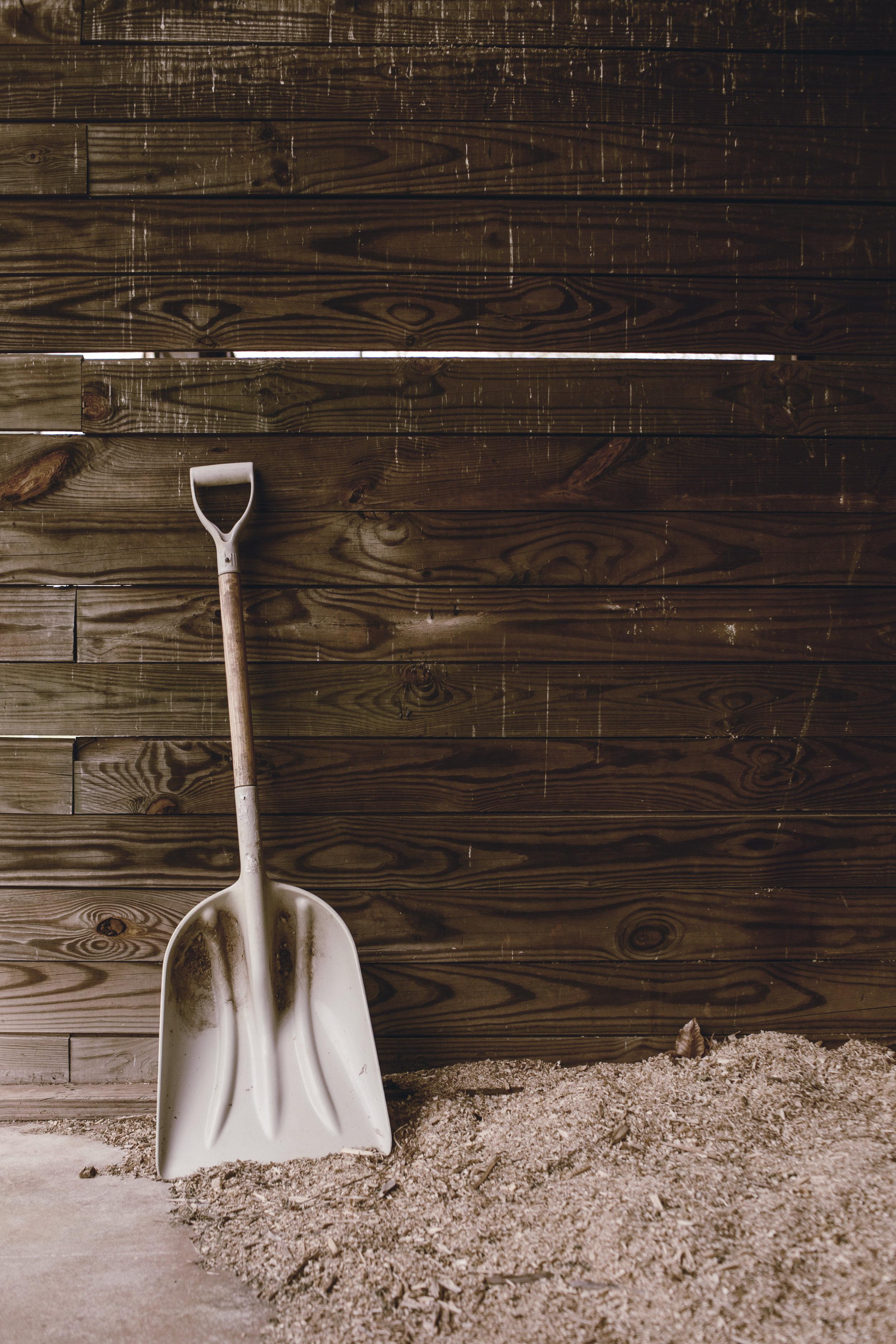 work shovel on rustic barn wood / heirloomed