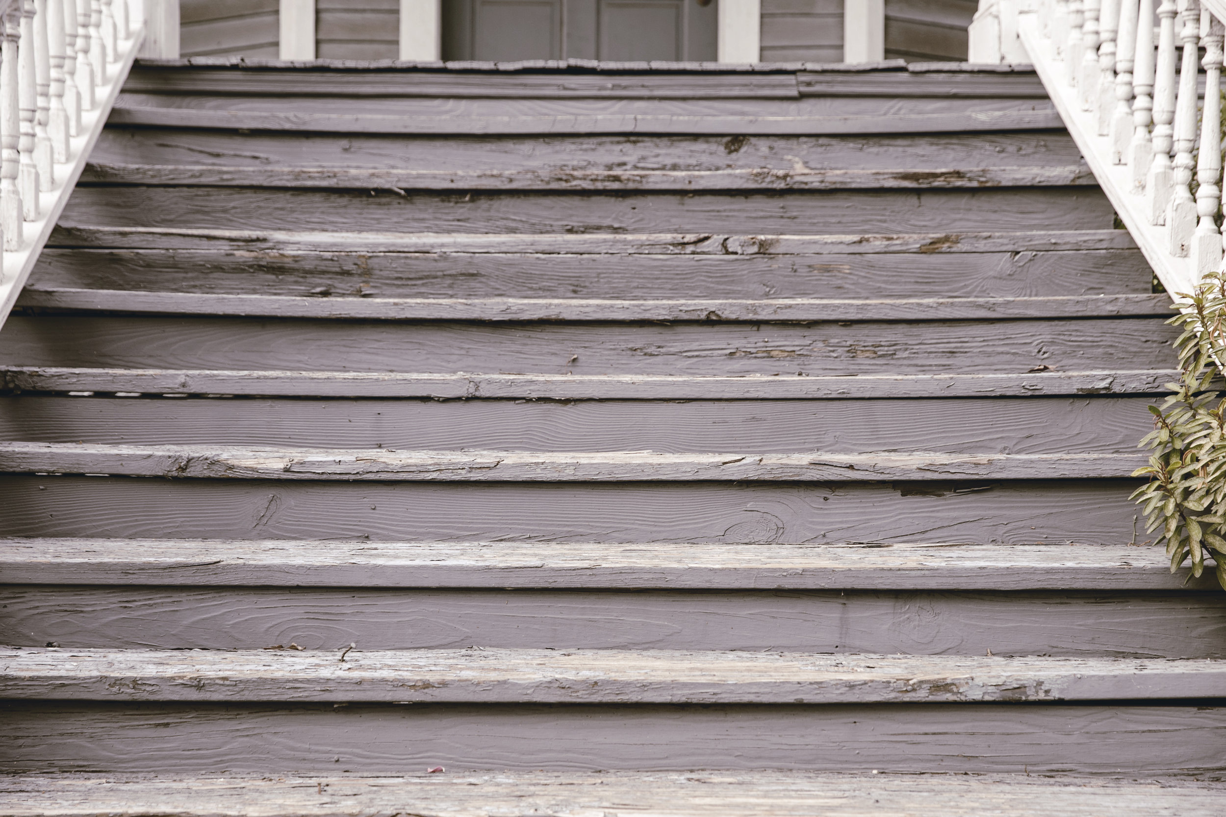 chipping paint front steps in grey blue / heirloomed