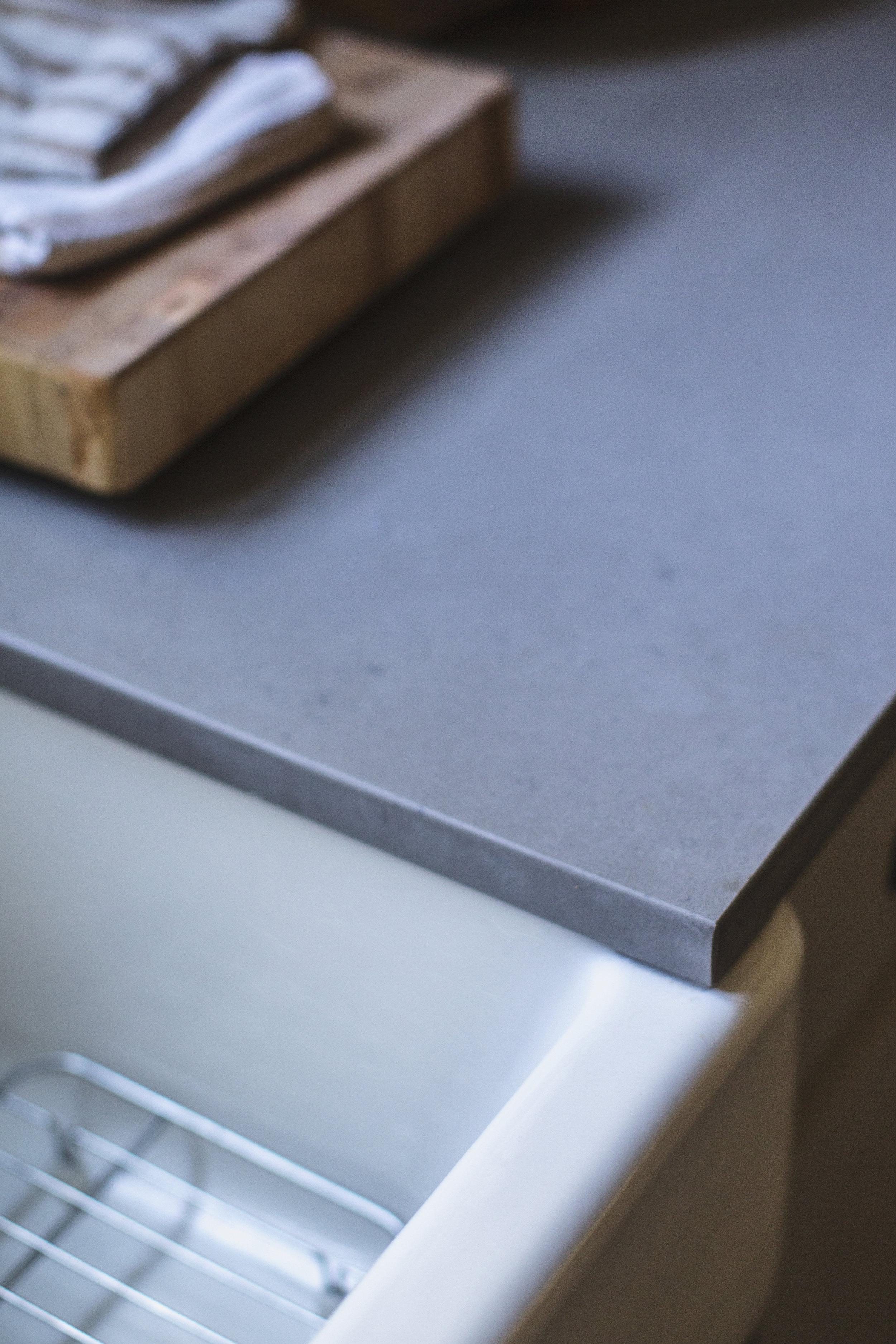 caesarstone quartz countertop in honed pebble / heirloomed