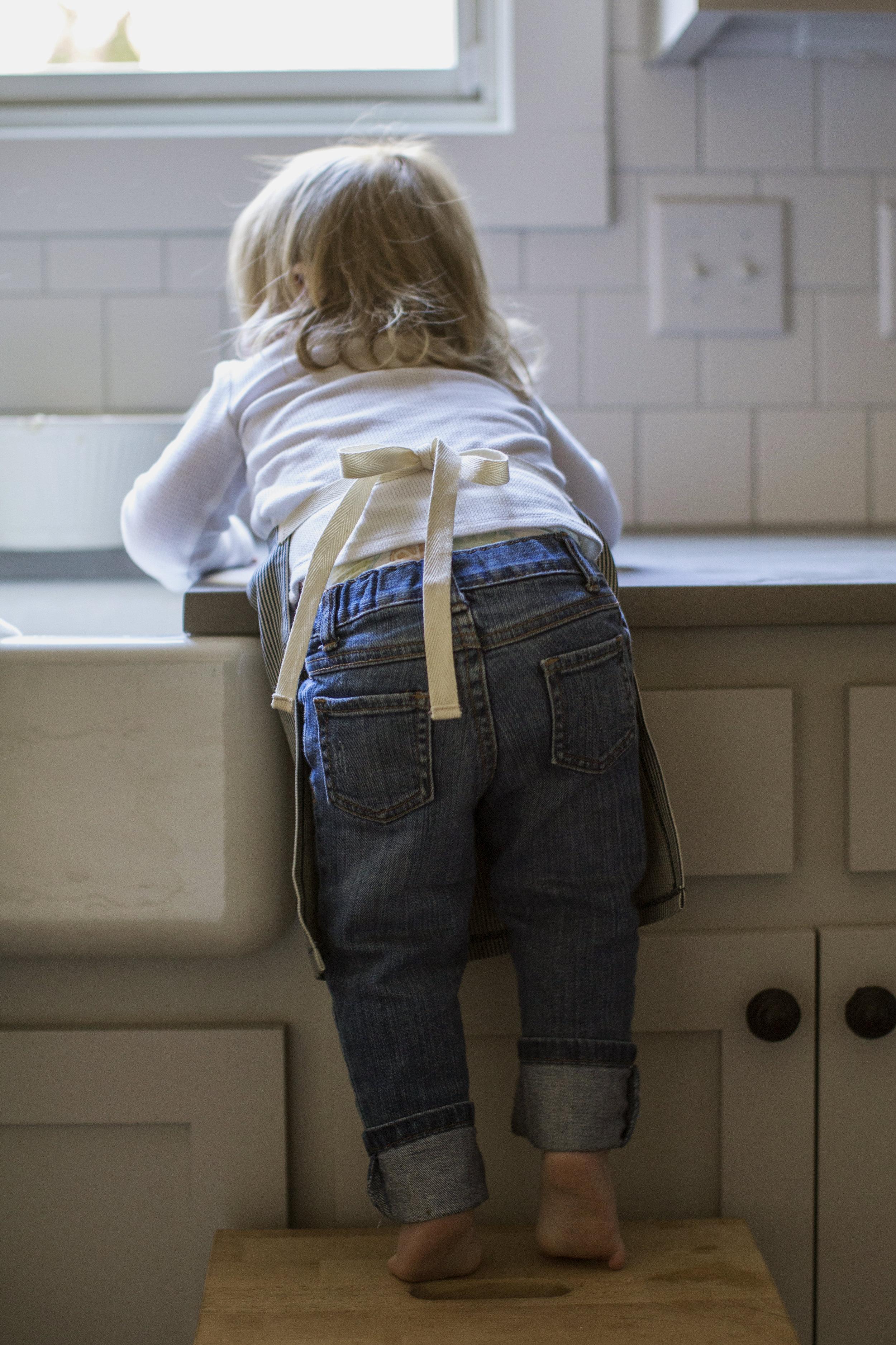 little kitchen helper in apron / heirloomed