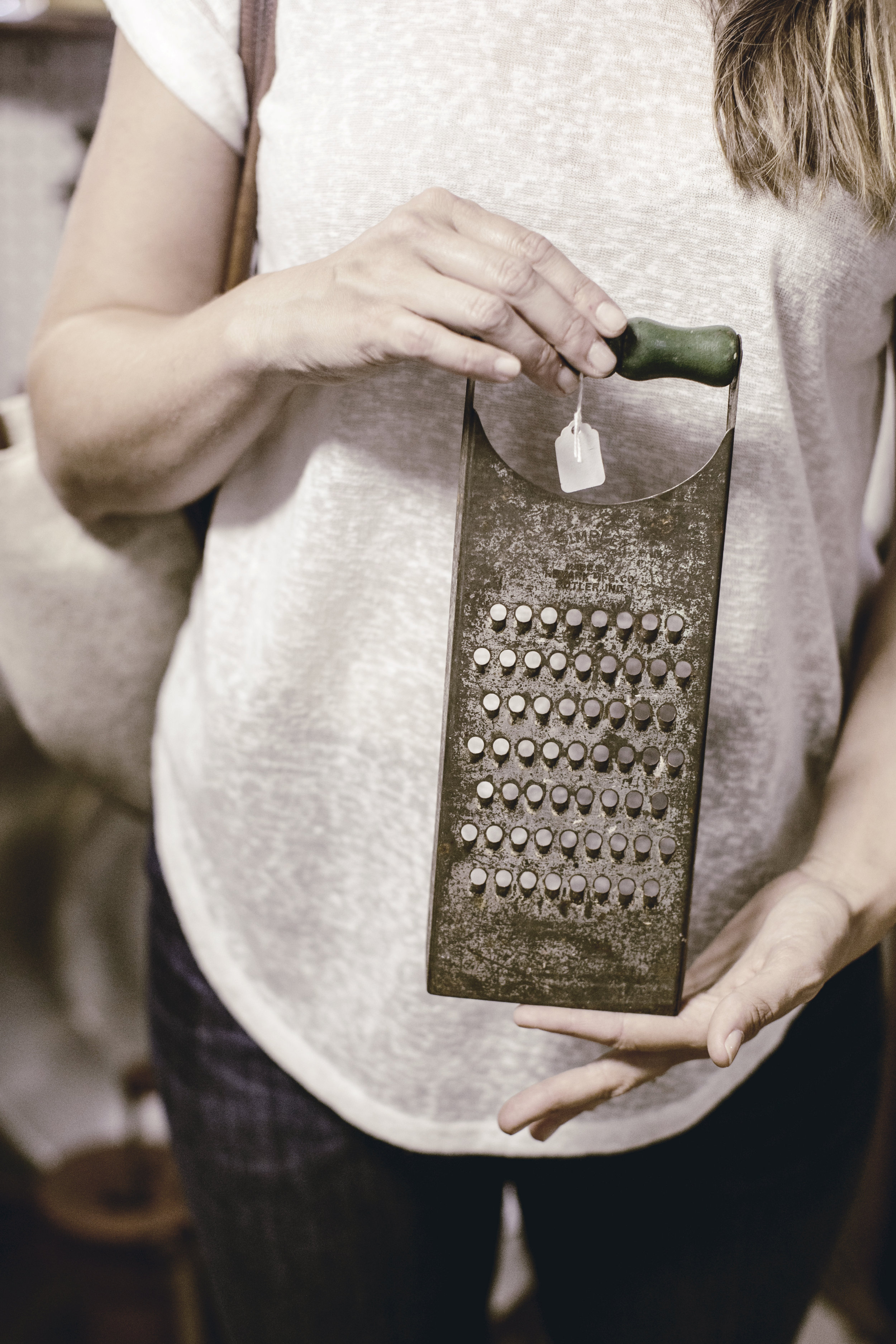 vintage metal cheese grater with green wooden handle / heirloomed