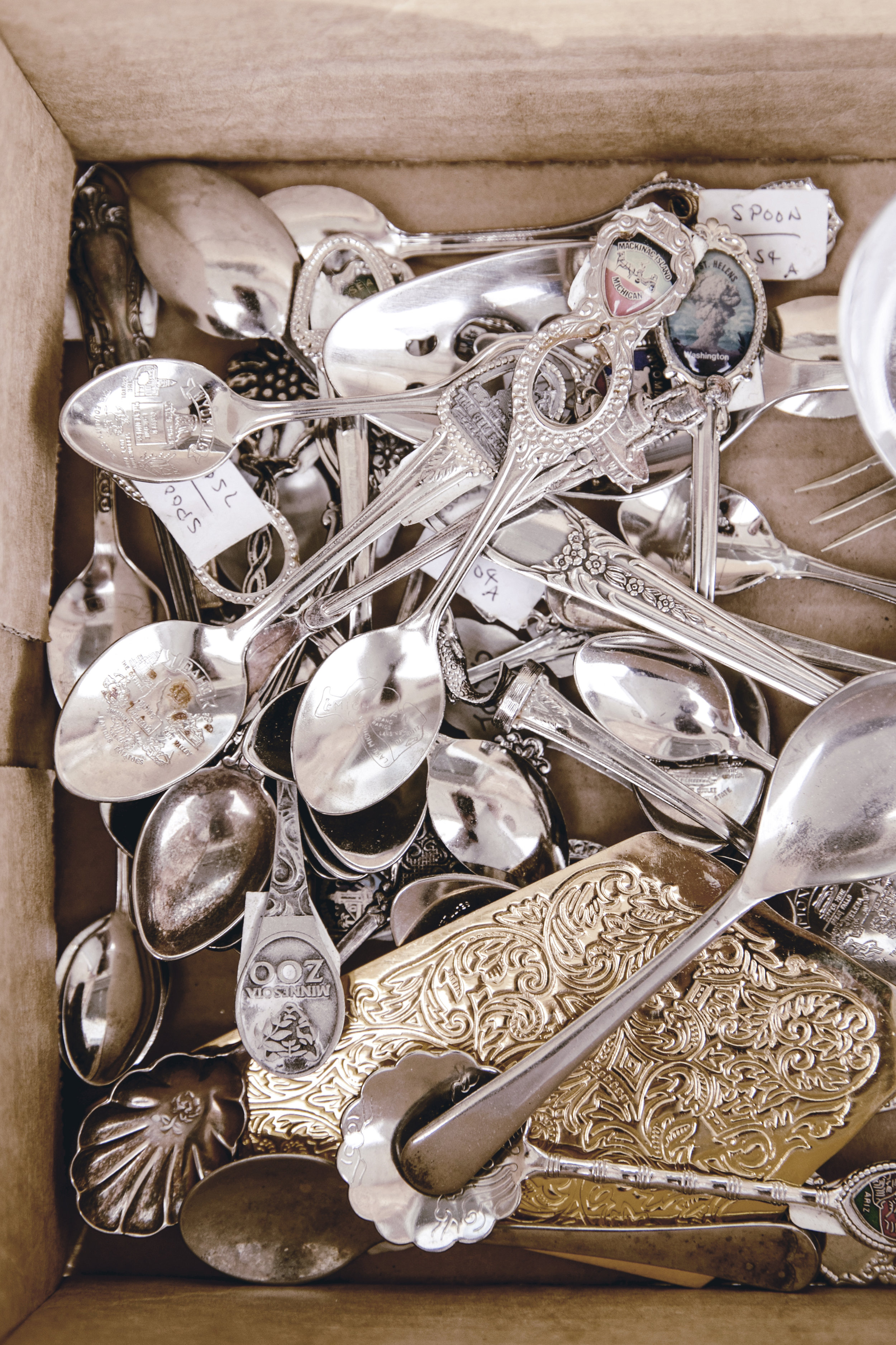box of vintage silverware and serving pieces /heirloomed