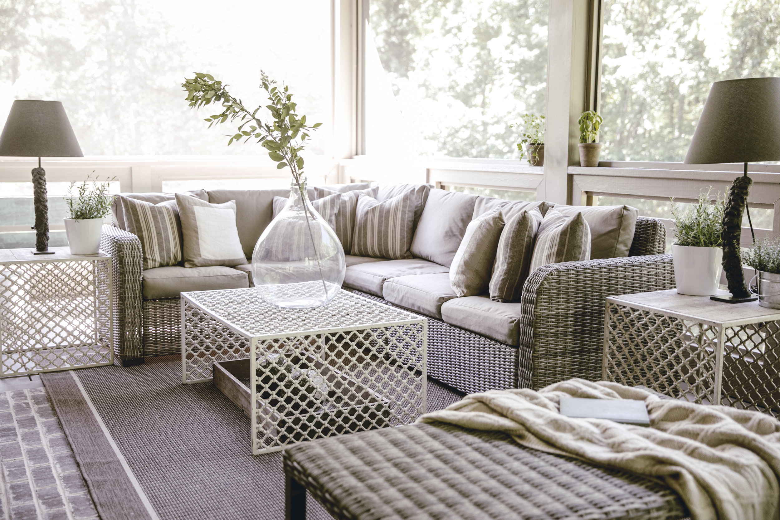cozy outdoor screened in patio space  / heirloomed