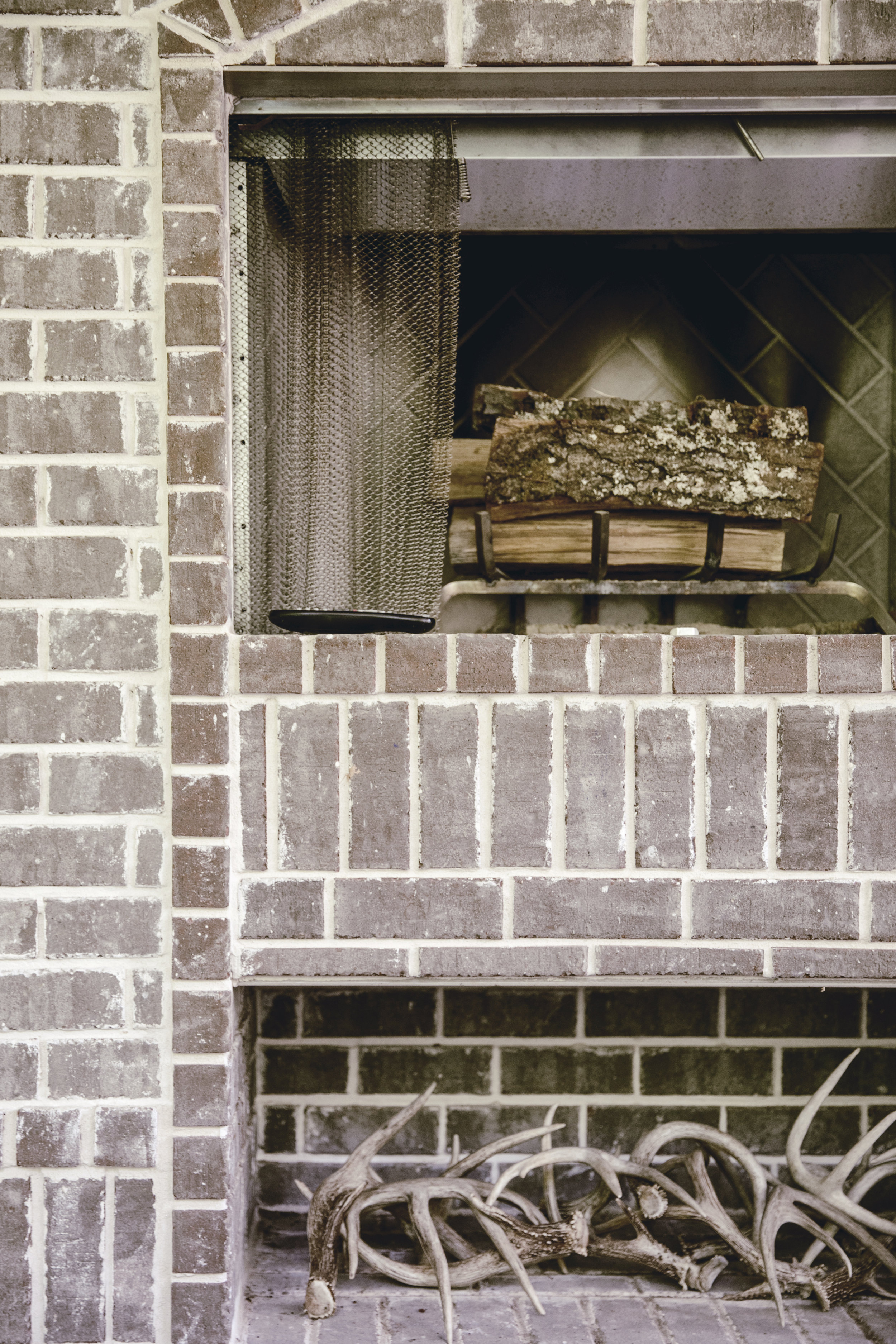outdoor fireplace and wood storage area / heirloomed