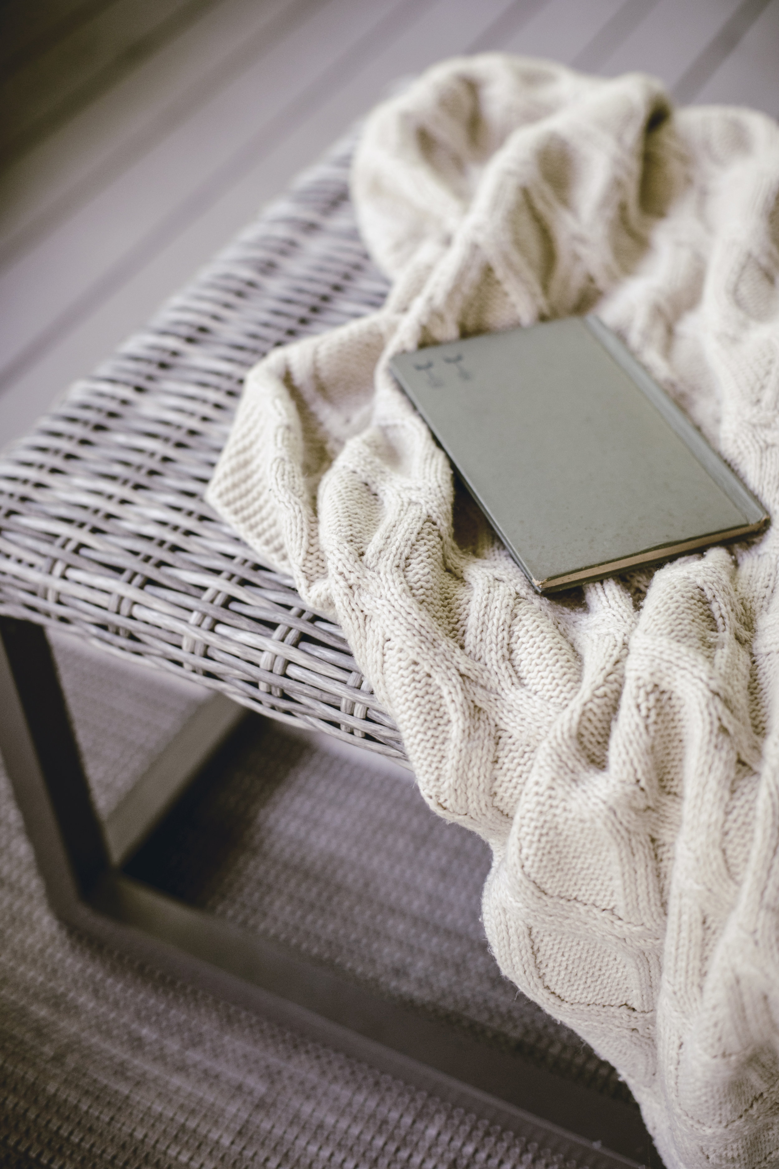 cozy blanket and book for reading on the back porch / heirloomed