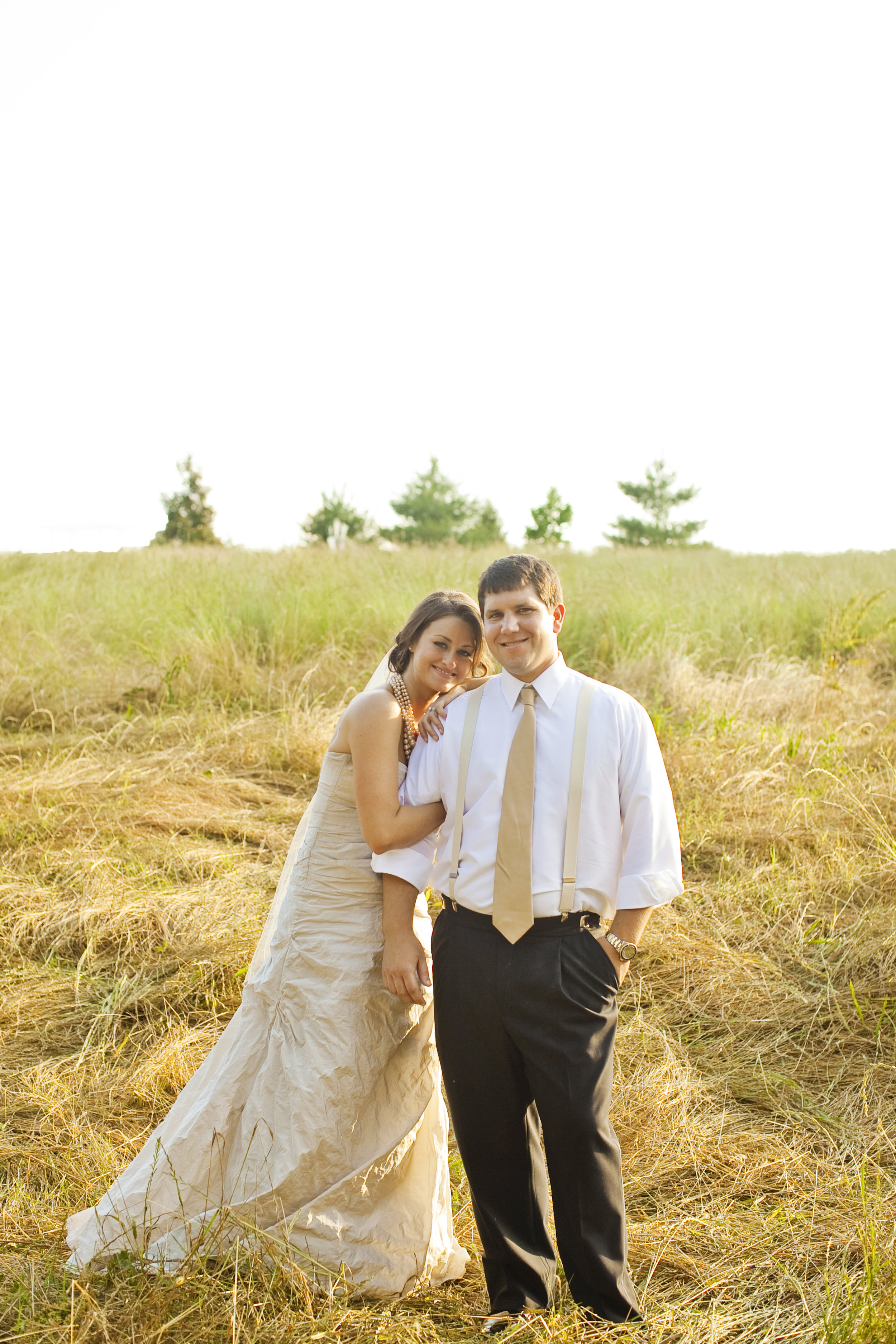 bride and groom in a field / heirloomed