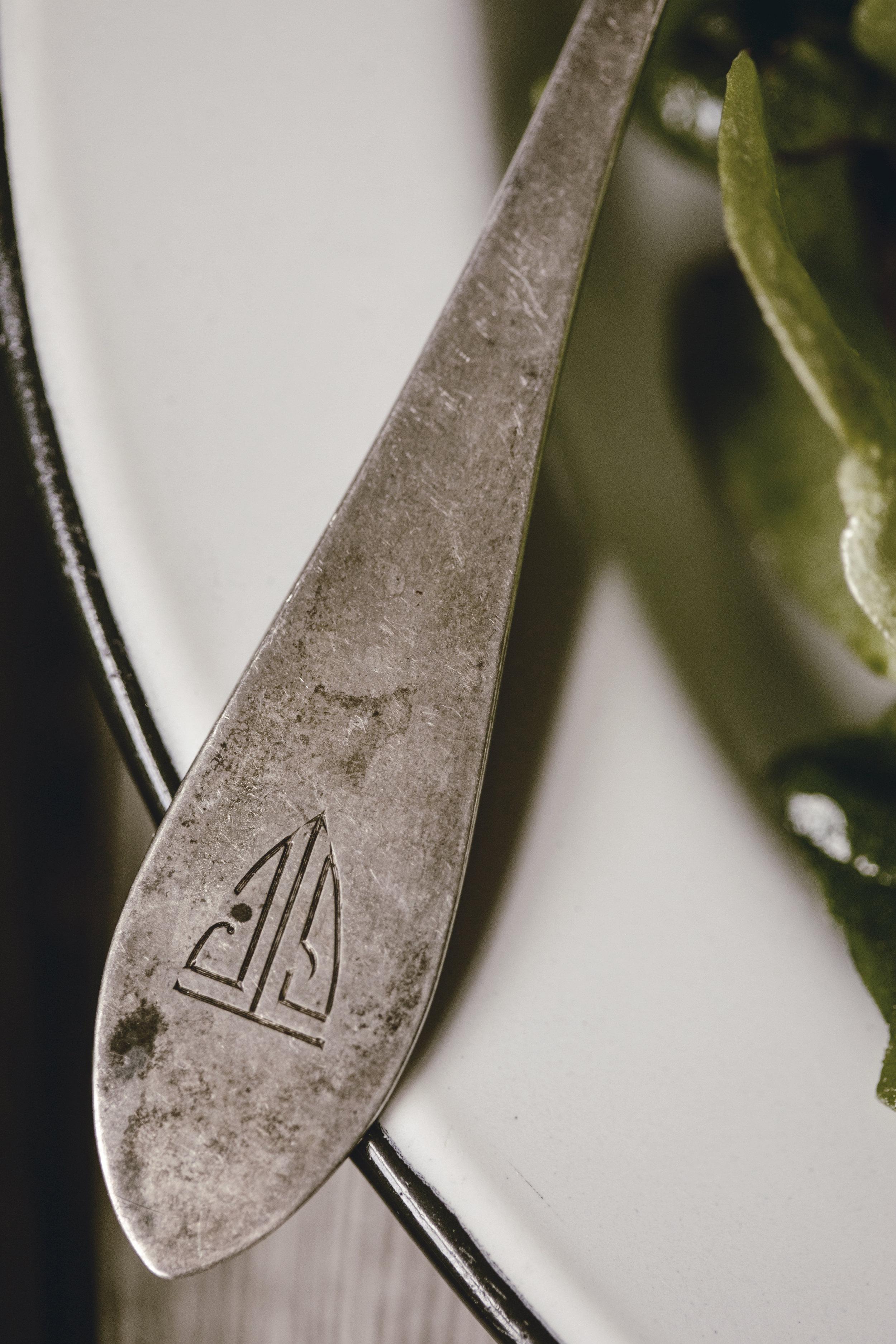 detail of personalized vintage silverware / heirloomed
