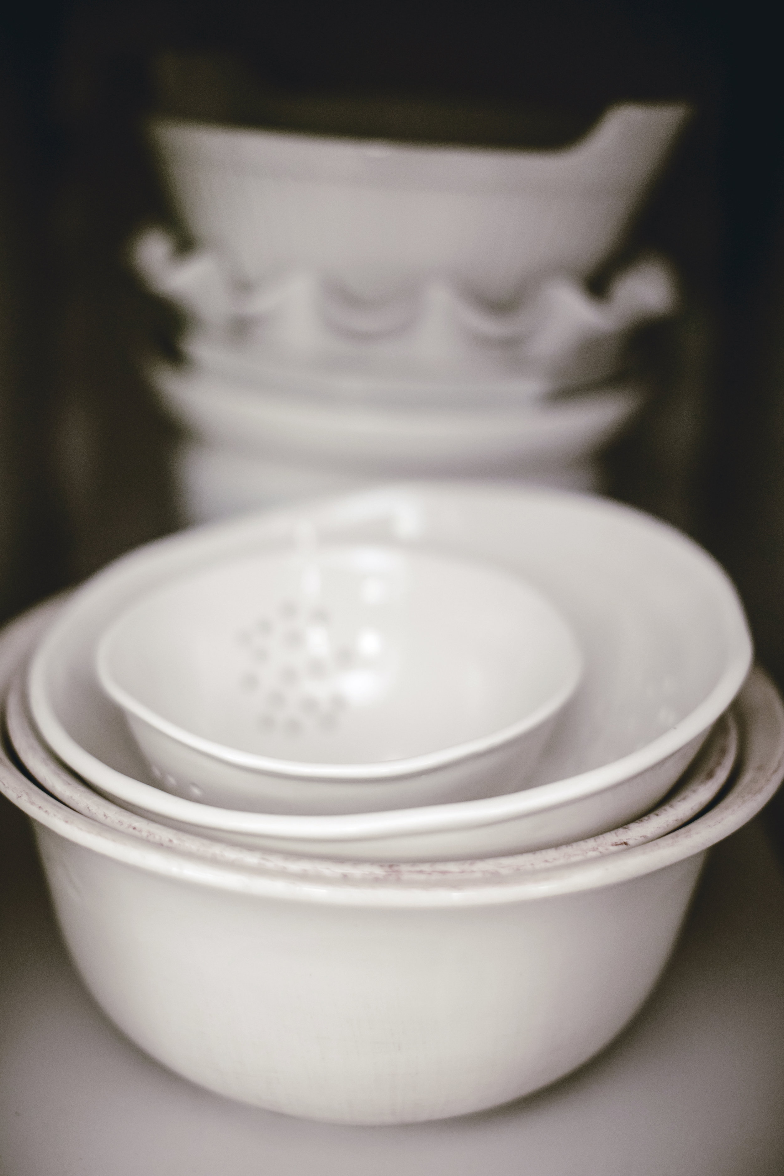 stacks of mismatched vintage white  mixing bowls / heirloomed