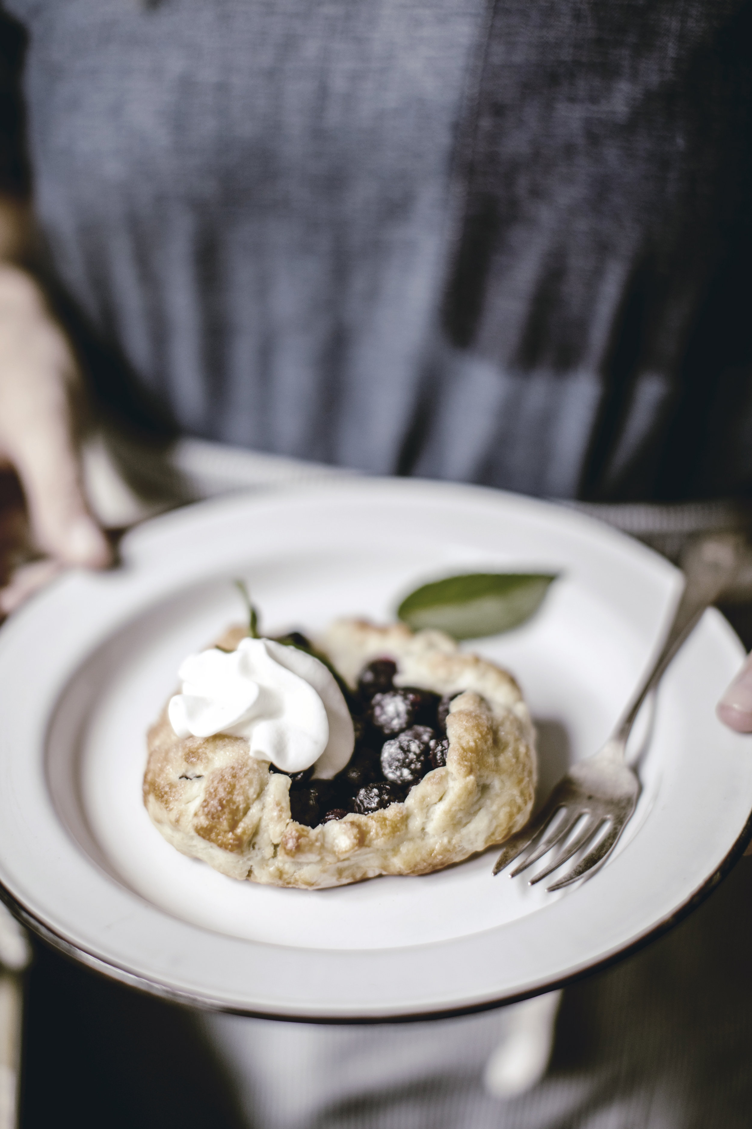 Rustic blueberry galette with homemade whipped cream / heirloomed
