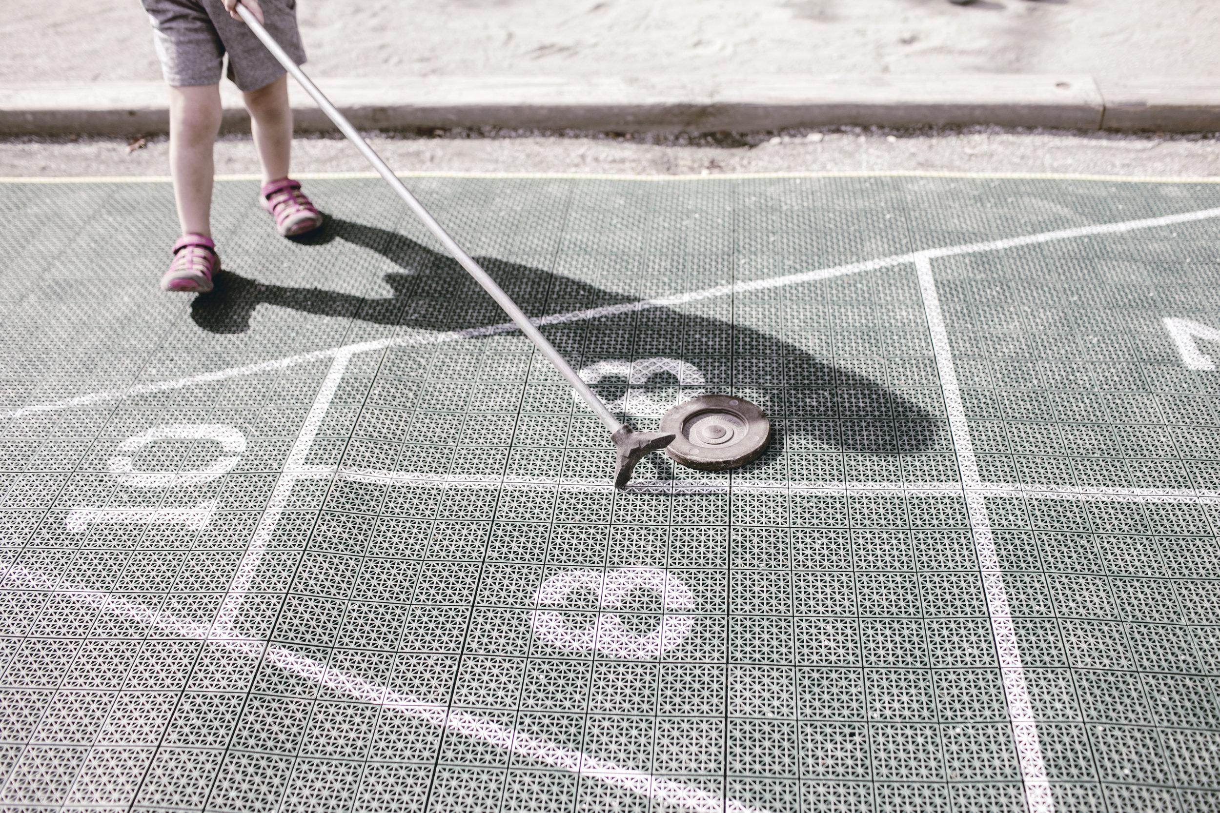 kids learning shuffleboard / heirloomed