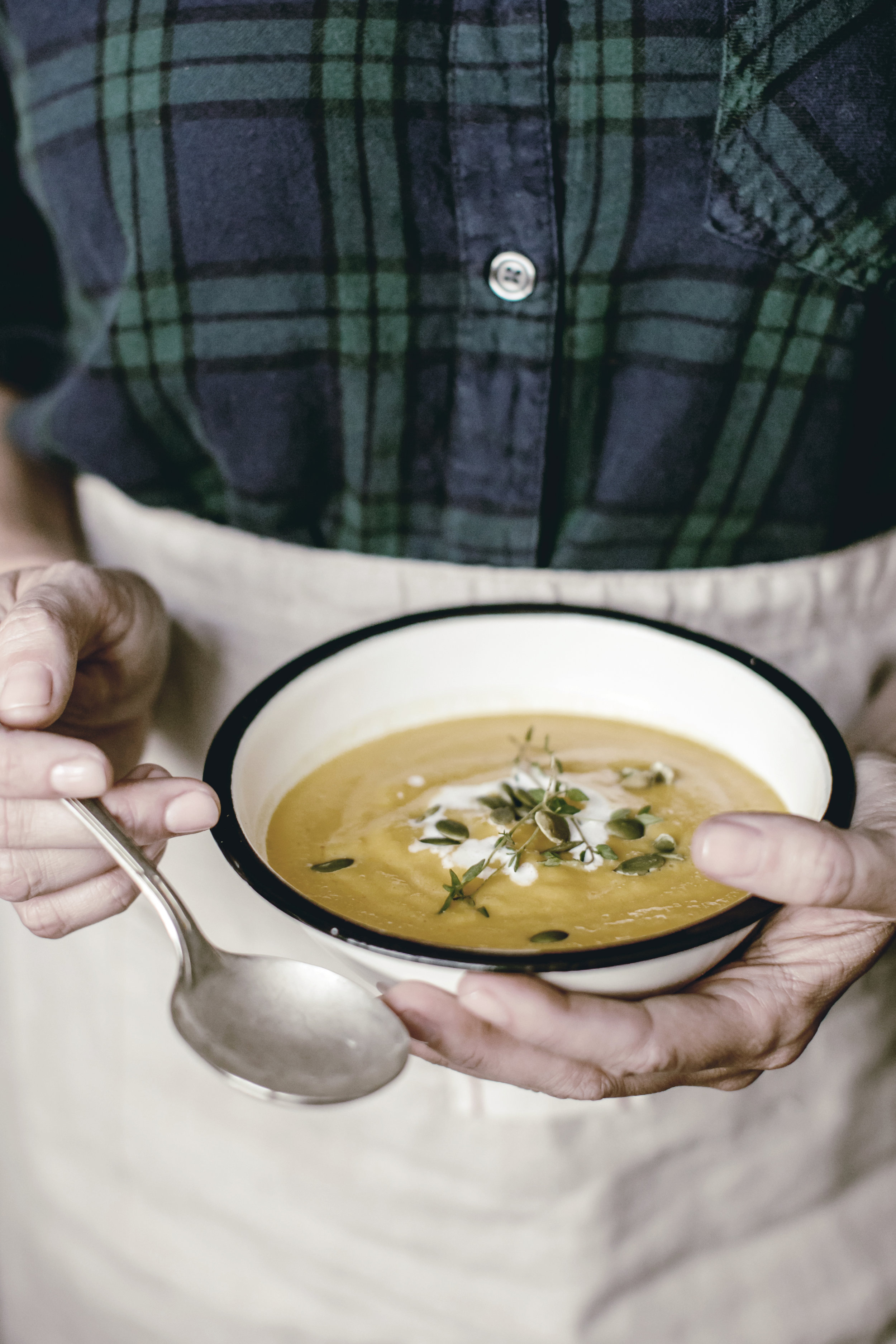eating hearty bowl of butternut squash soup / heirloomed