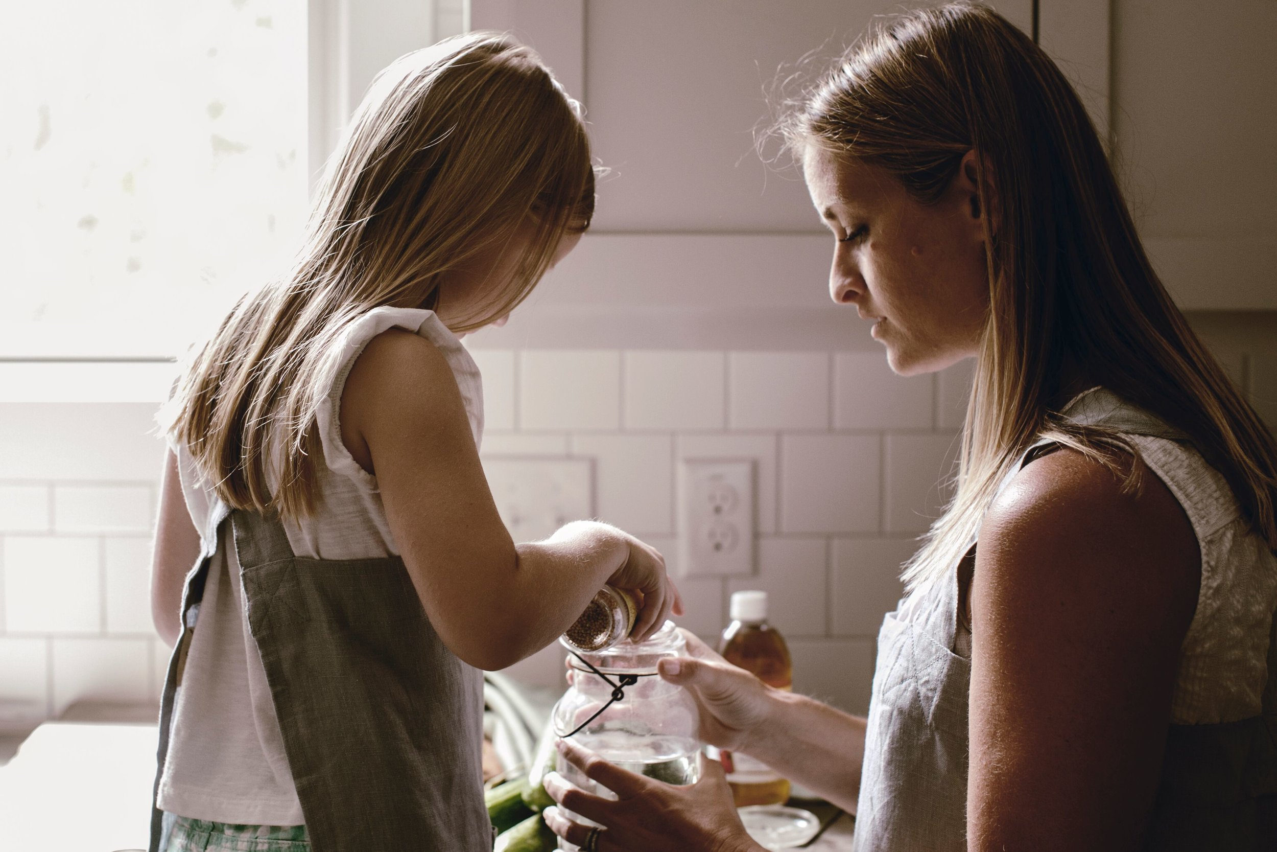 mom and daughter in the kitchen by heirloomed