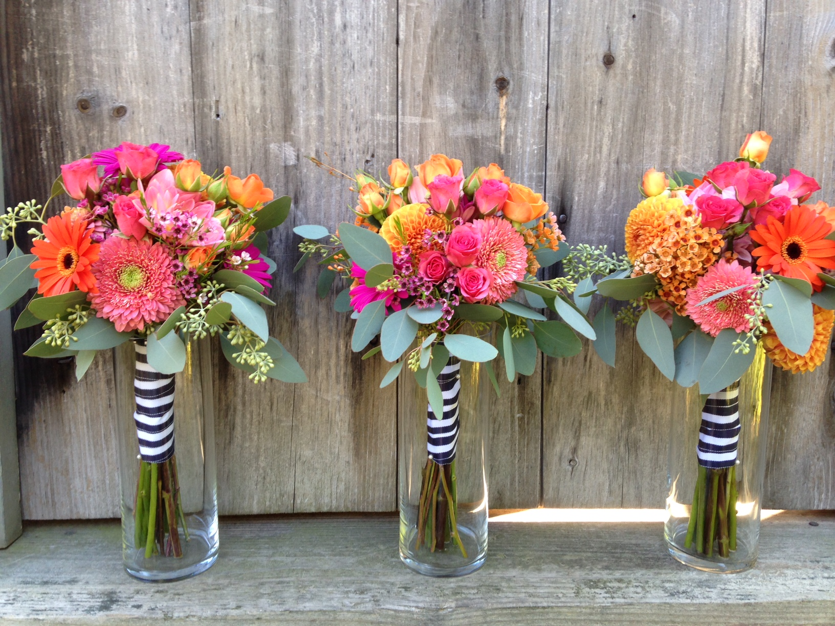 coral, fuschia & orange bouquets.jpg