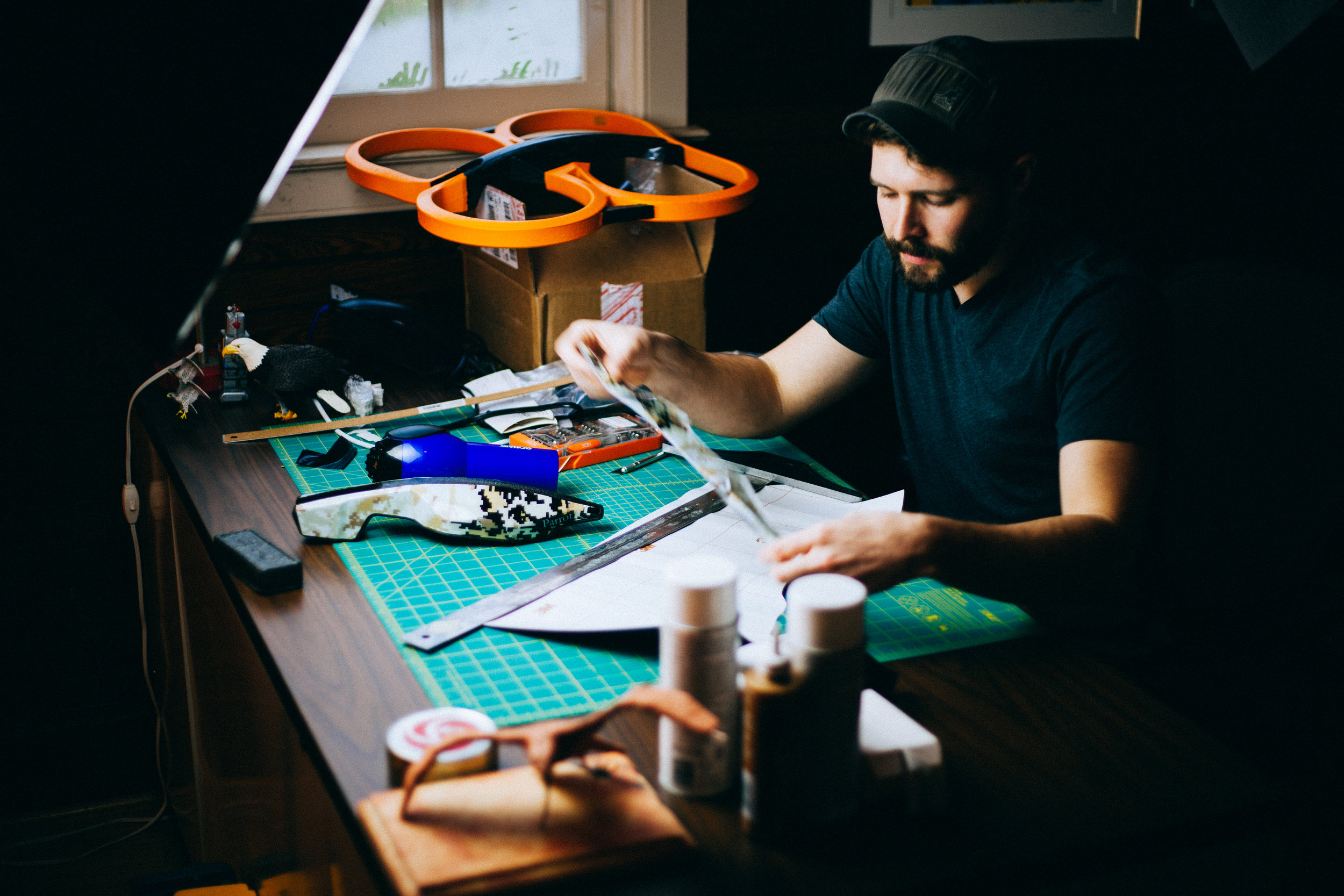 Behind the scenes creating new templates for the drone's carbon fiber bodywork. Orange color-matching test sits in the background.
