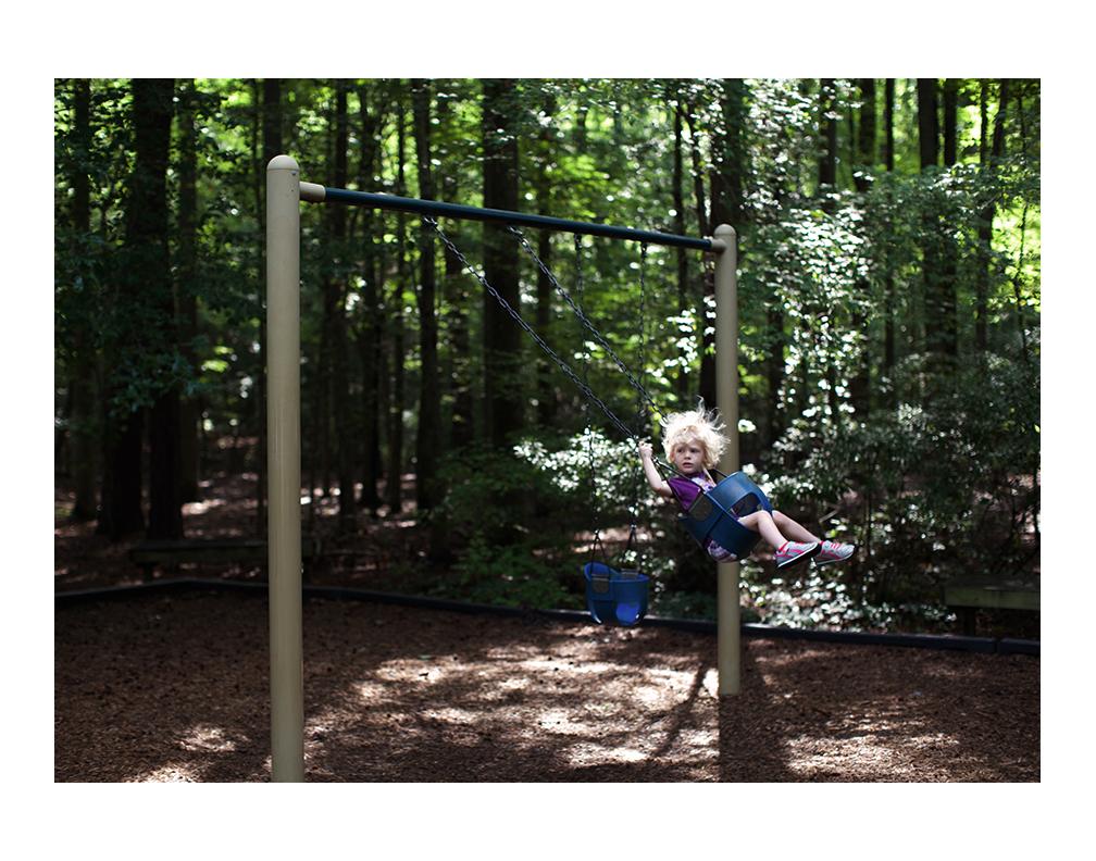 Elena swinging in Sandy Bottom Nature Park.