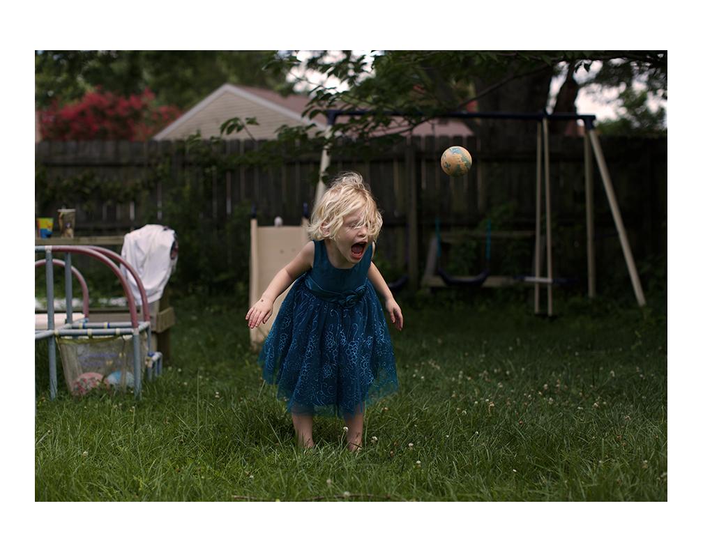 Elena playing in her backyard.