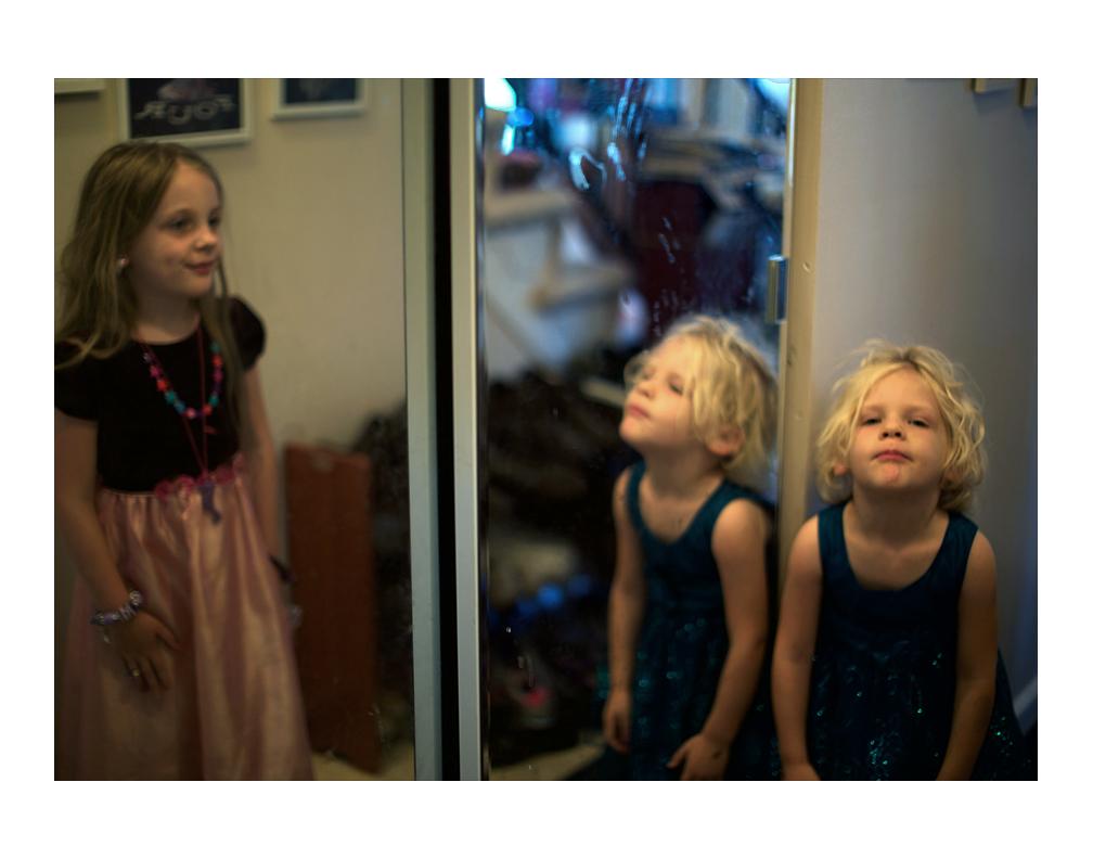 Karina and Elena playing dress up around the house.