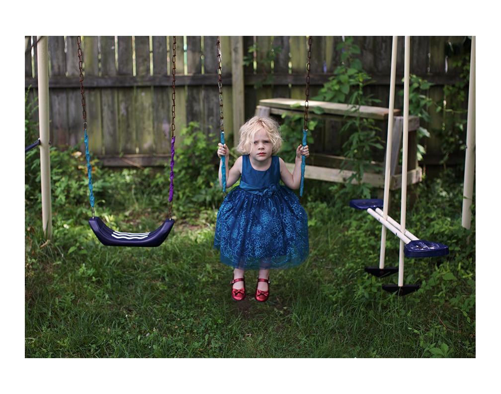 Elena wanting to swing in her backyard.
