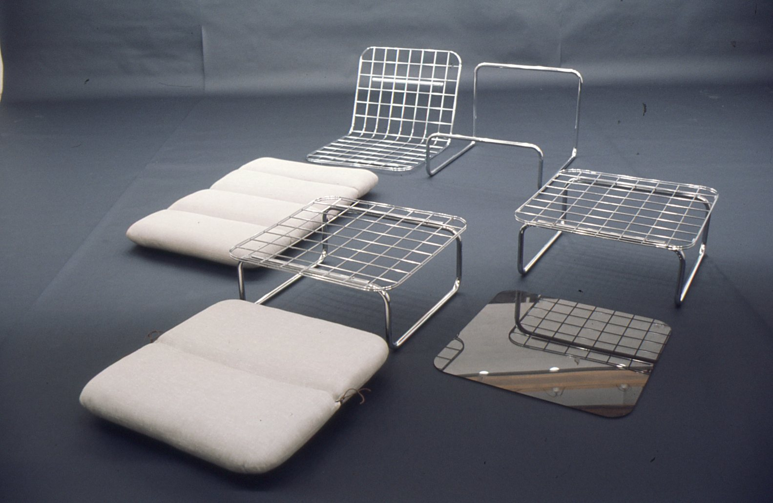 Chair 666, table T856 and hocker P656 in parts. Photo X
