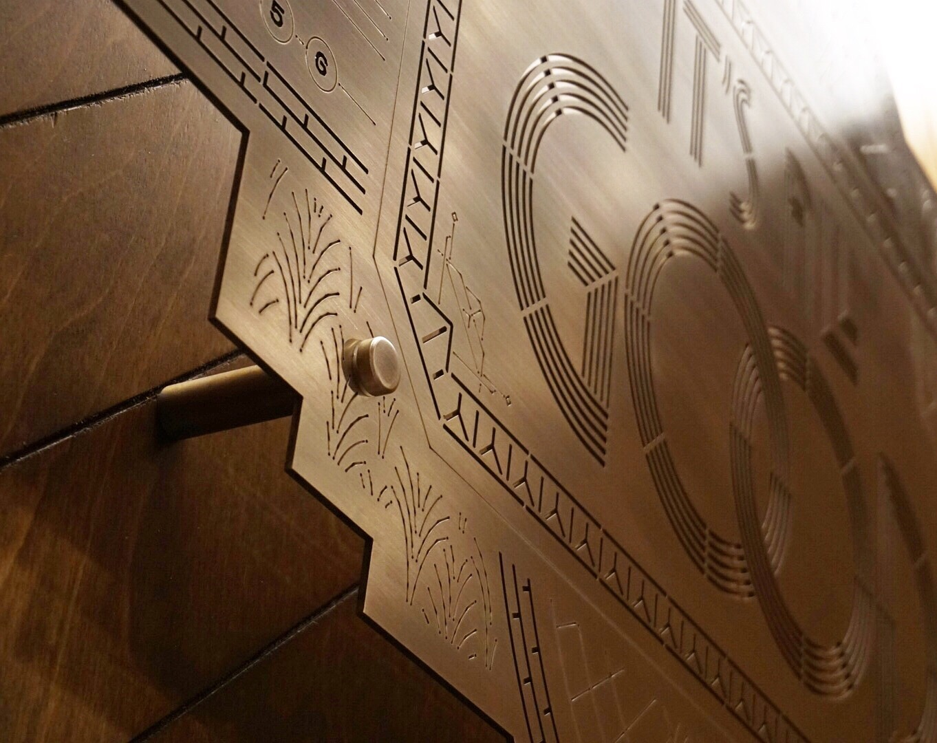 """""""Same number, same hood. It's all Good""""   Engraved brass installation for WeWork 57th Street. nspired by NYC art deco buildings, subway rats and Biggie lyrics.  Art Direction by Jeremiah Britton, Interior Design by Alex Snyder"""