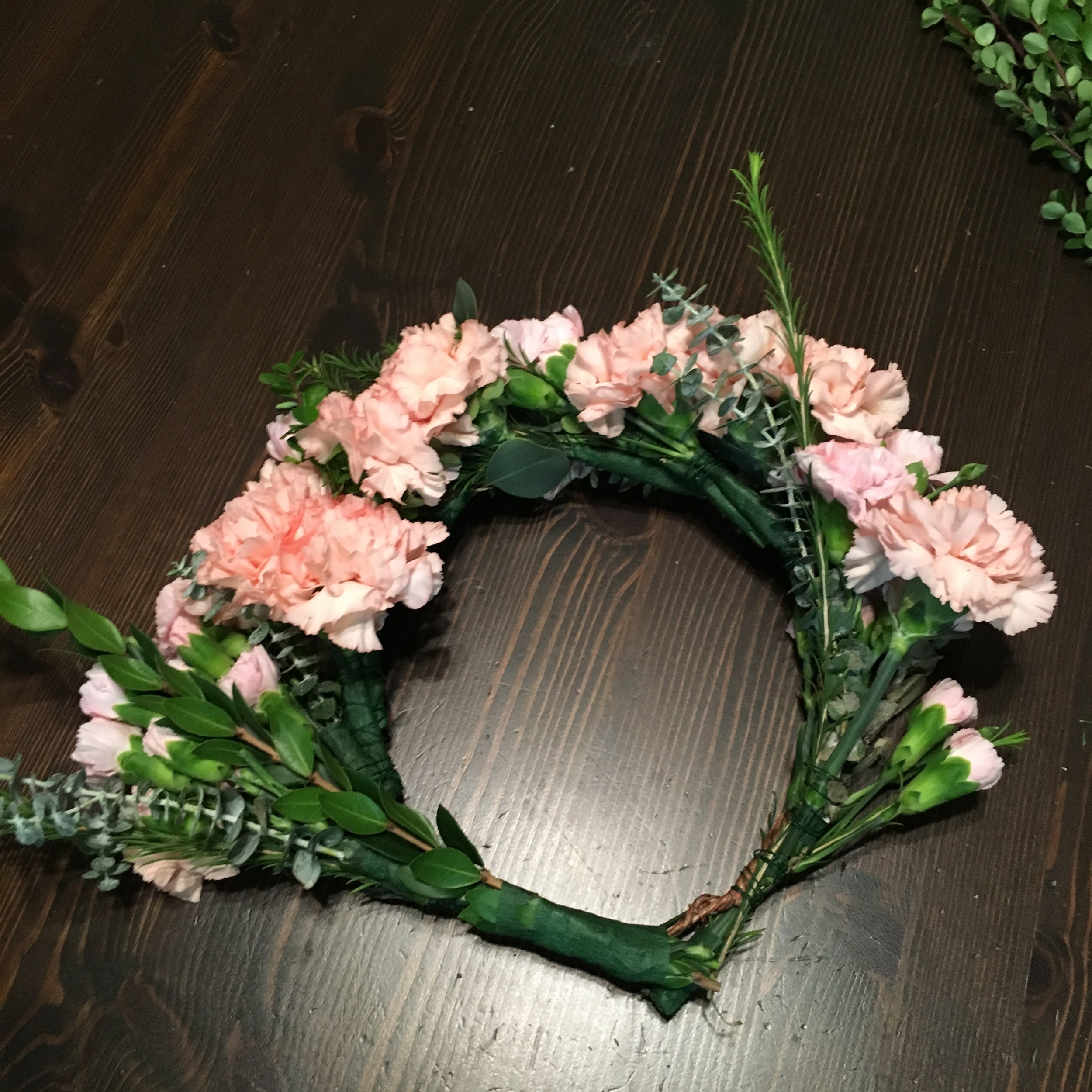 once you've attached all of your bunches, add in the longer ones. one on each side. and you're done!  your crown looks great!!