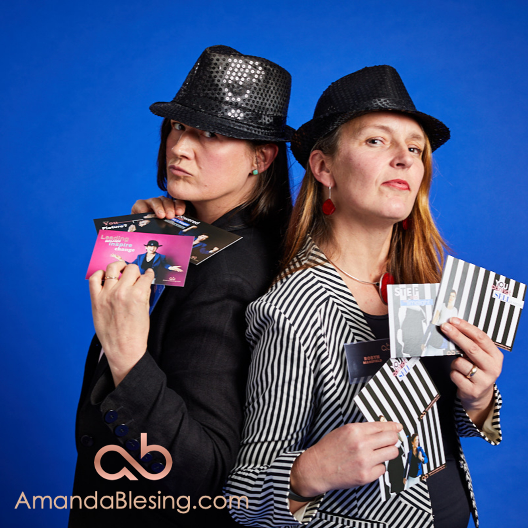 Getting into the spirit of things! Clients posing to re-envisage the front cover of the book - From Invisible to Invincible: a self-promotion handbook for Executive Women - by Amanda Blesing