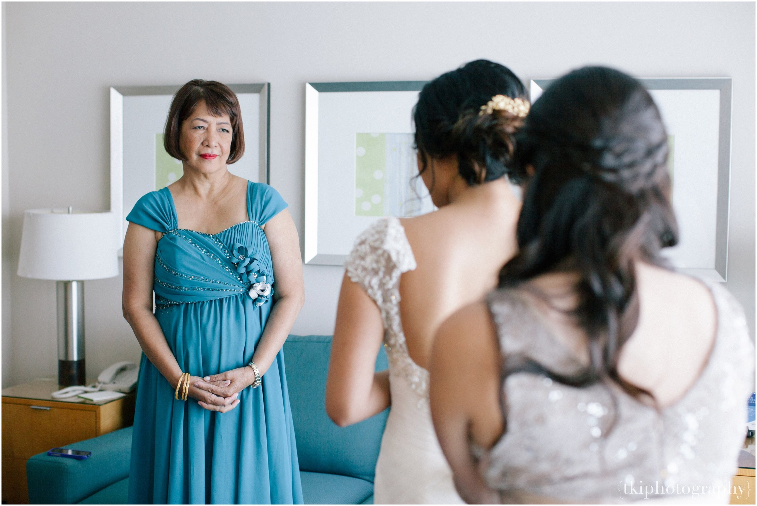 This is my favorite moment, and I always make sure I look out for it in hope that I don't miss any amount of emotion expressed as she watches her daughter transform into a beautiful bride.