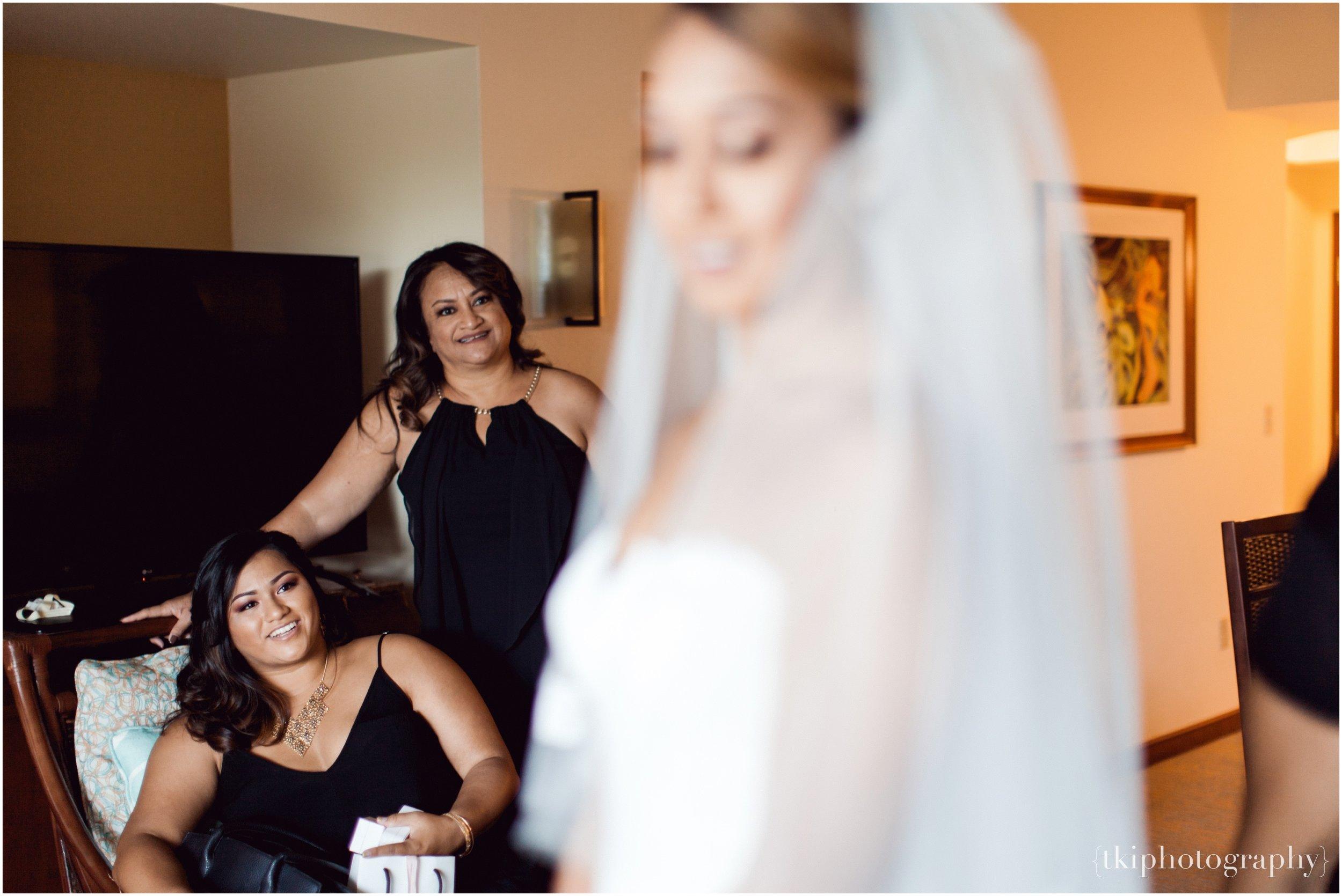 Bridesmaids watching the bride