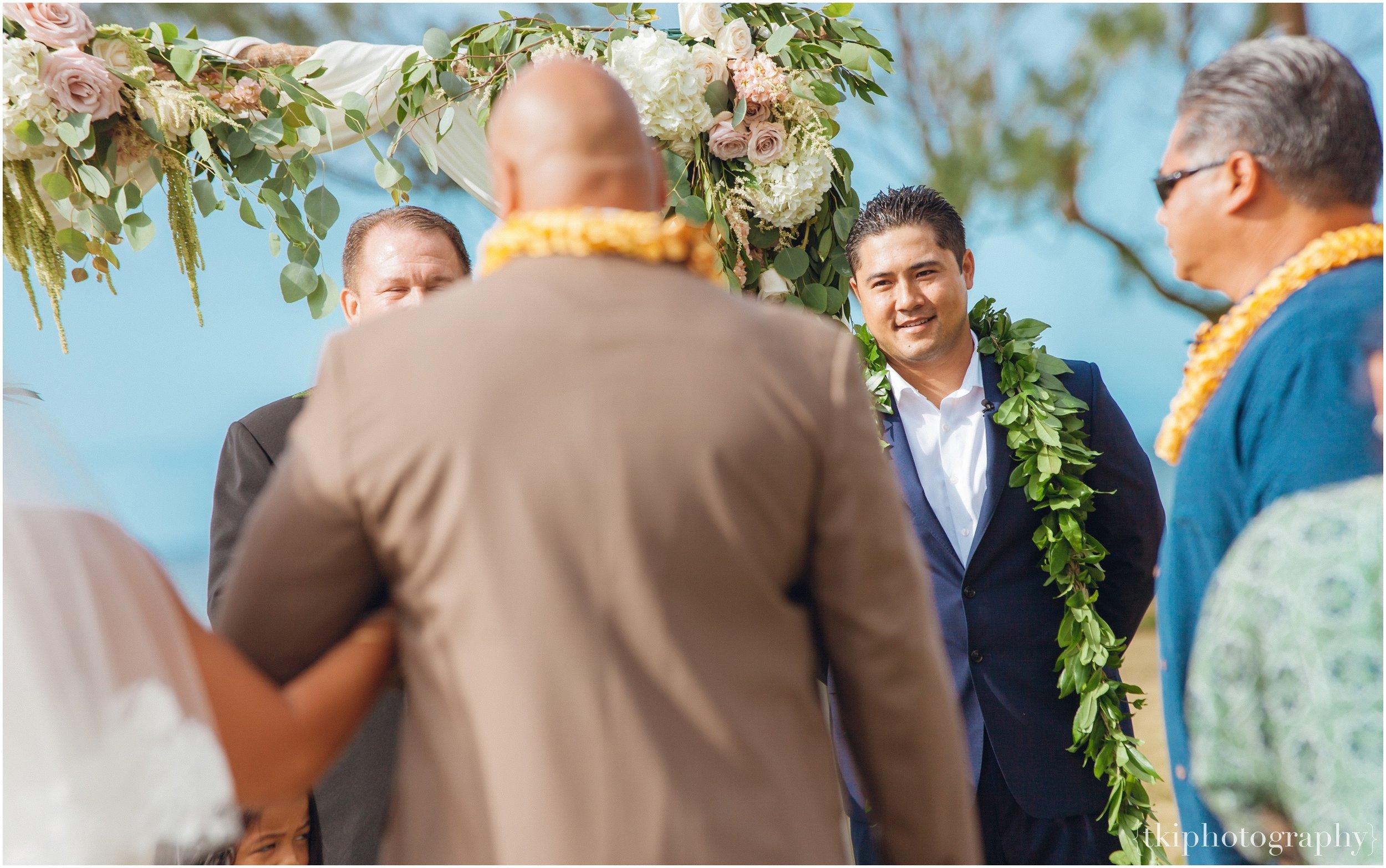 Groom in awe of his Bride