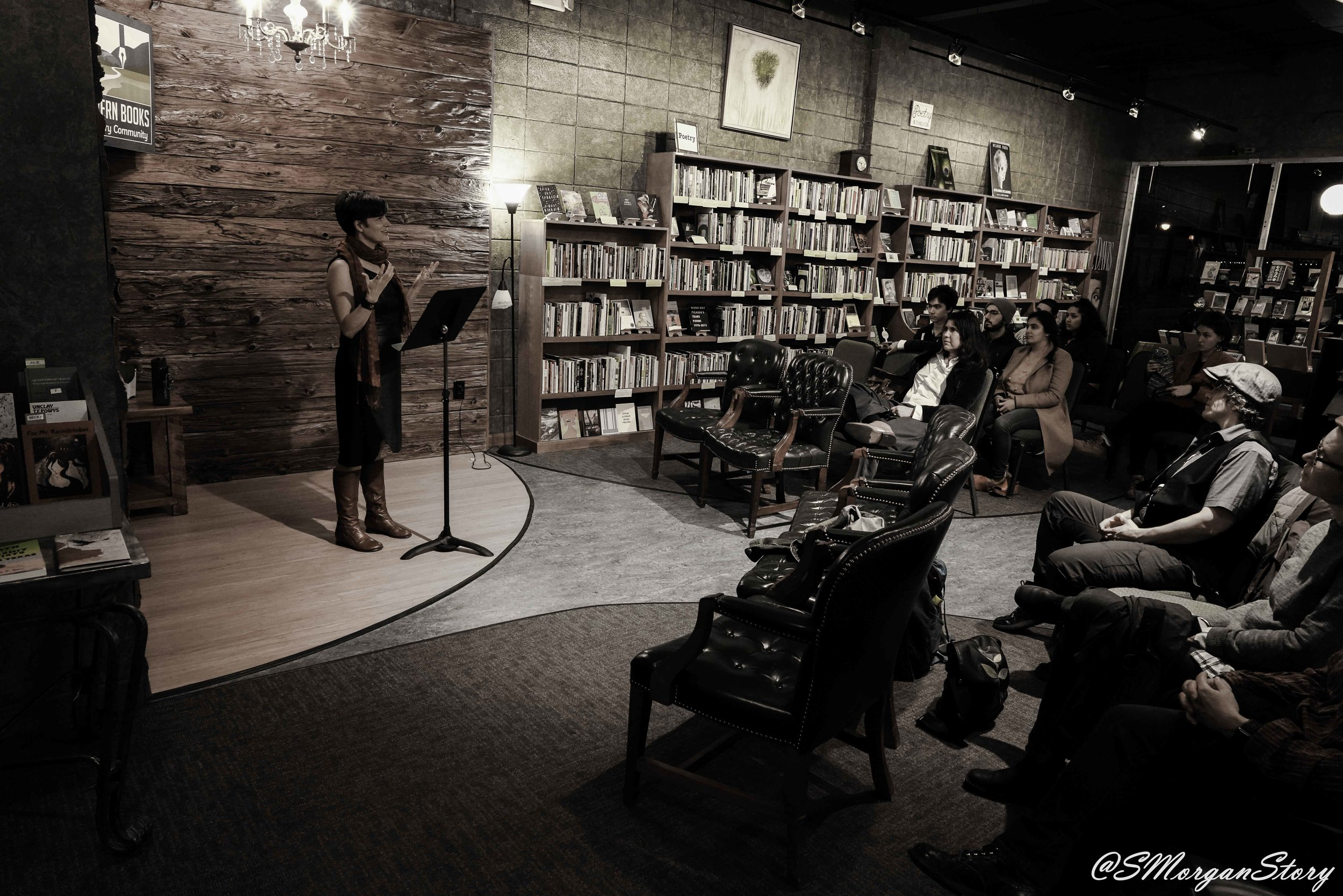 Poet, Allison Cobb, on stage at Malvern Books, March 2019 in Austin Texas.