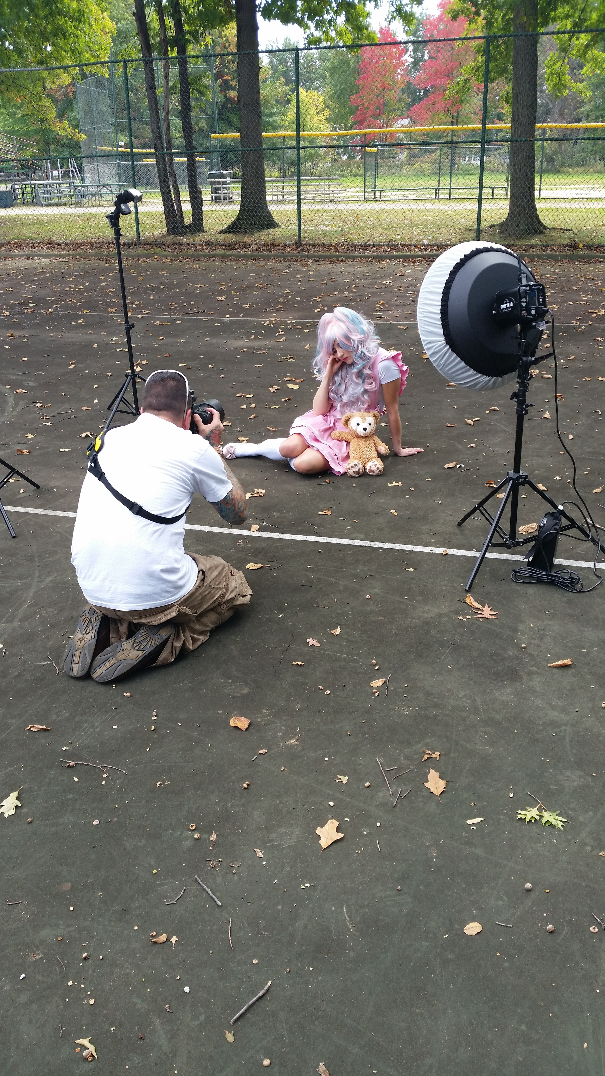 A photographer shoots a model at one of Christine's makeup gigs.