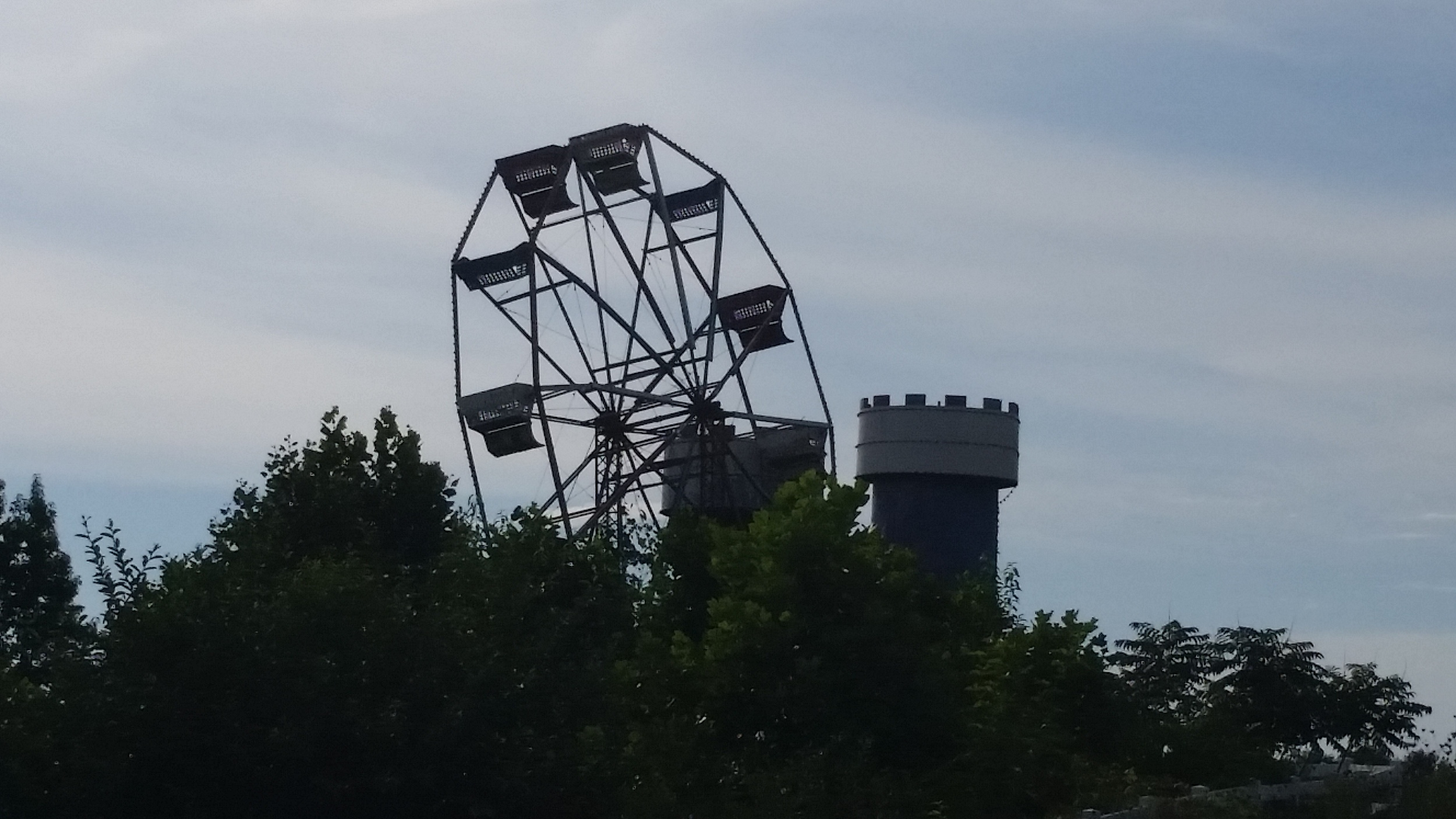I really wanted to explore this abandoned amusement park we passed between Cincinnati and Tennessee, but it just wasn't possible. But I did snap this shot of the overgrown, lopsided ferris wheel.