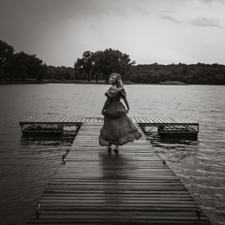 meg-senior-girl-running-on-dock-with-dress-grays-lake-ankeny-high-school-desmoines-iowa-raelyn-ramey-photography-81.jpg