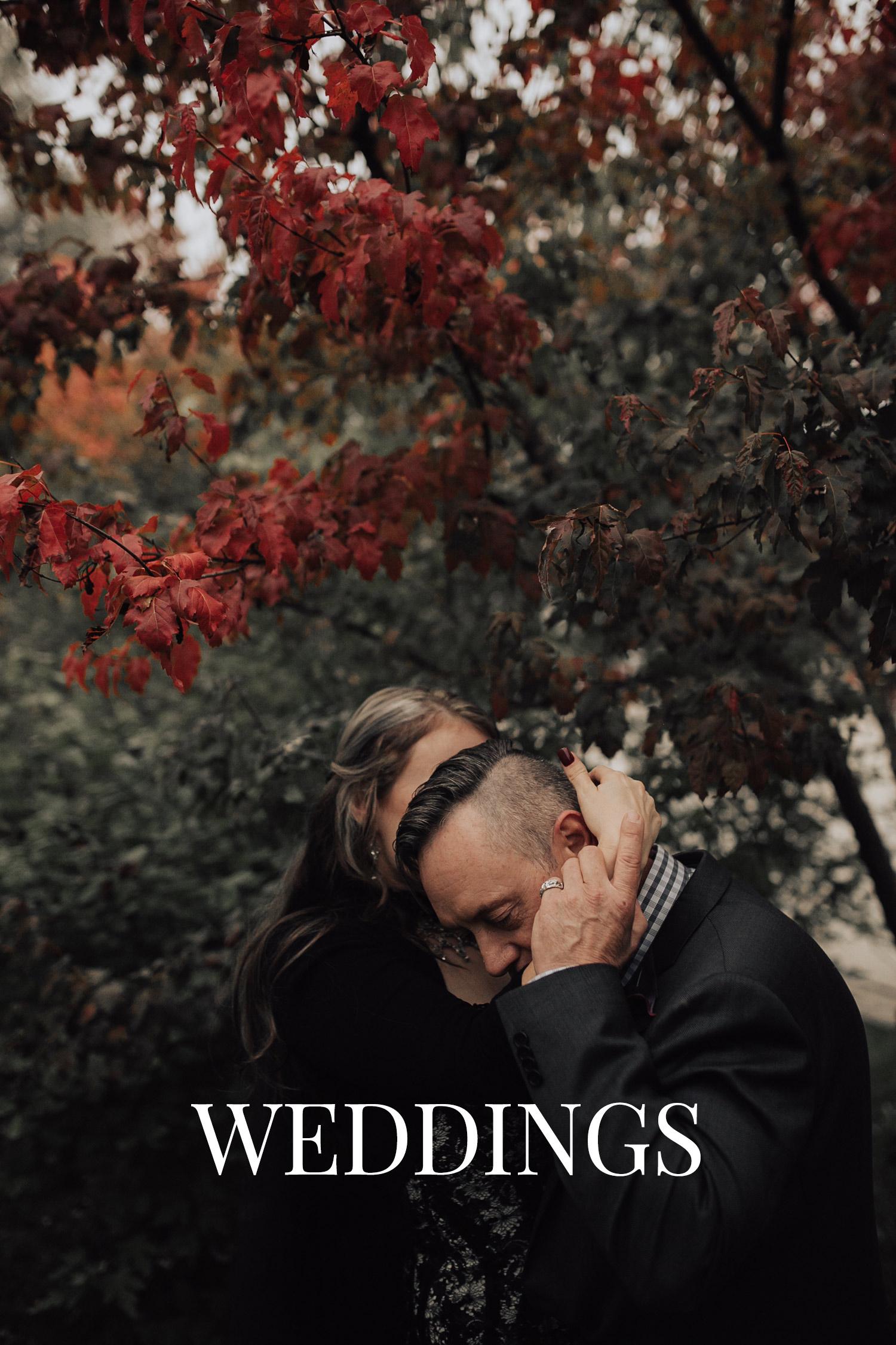 vanzee-couple-kissing-fall-red-tree-raelyn-ramey-photography.jpg