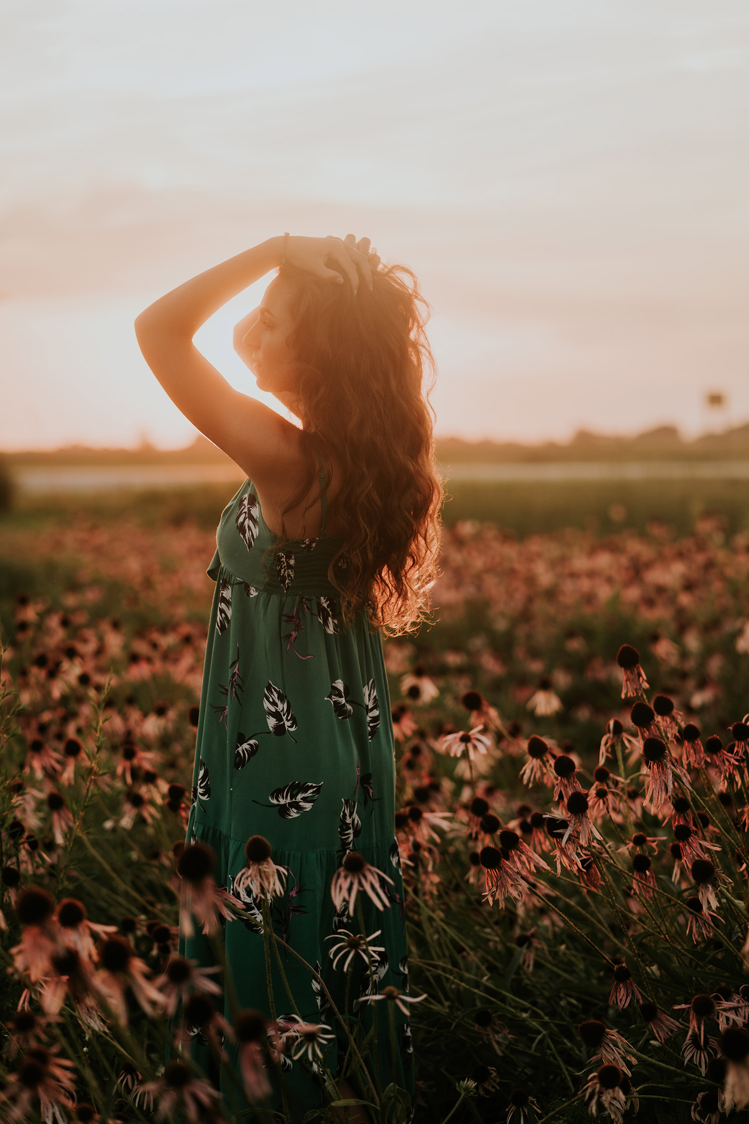 lizzy-senior--girl-flower-field-holding-hair-winterset-ankeny-high-school-desmoines-iowa-raelyn-ramey-photography-128.jpg
