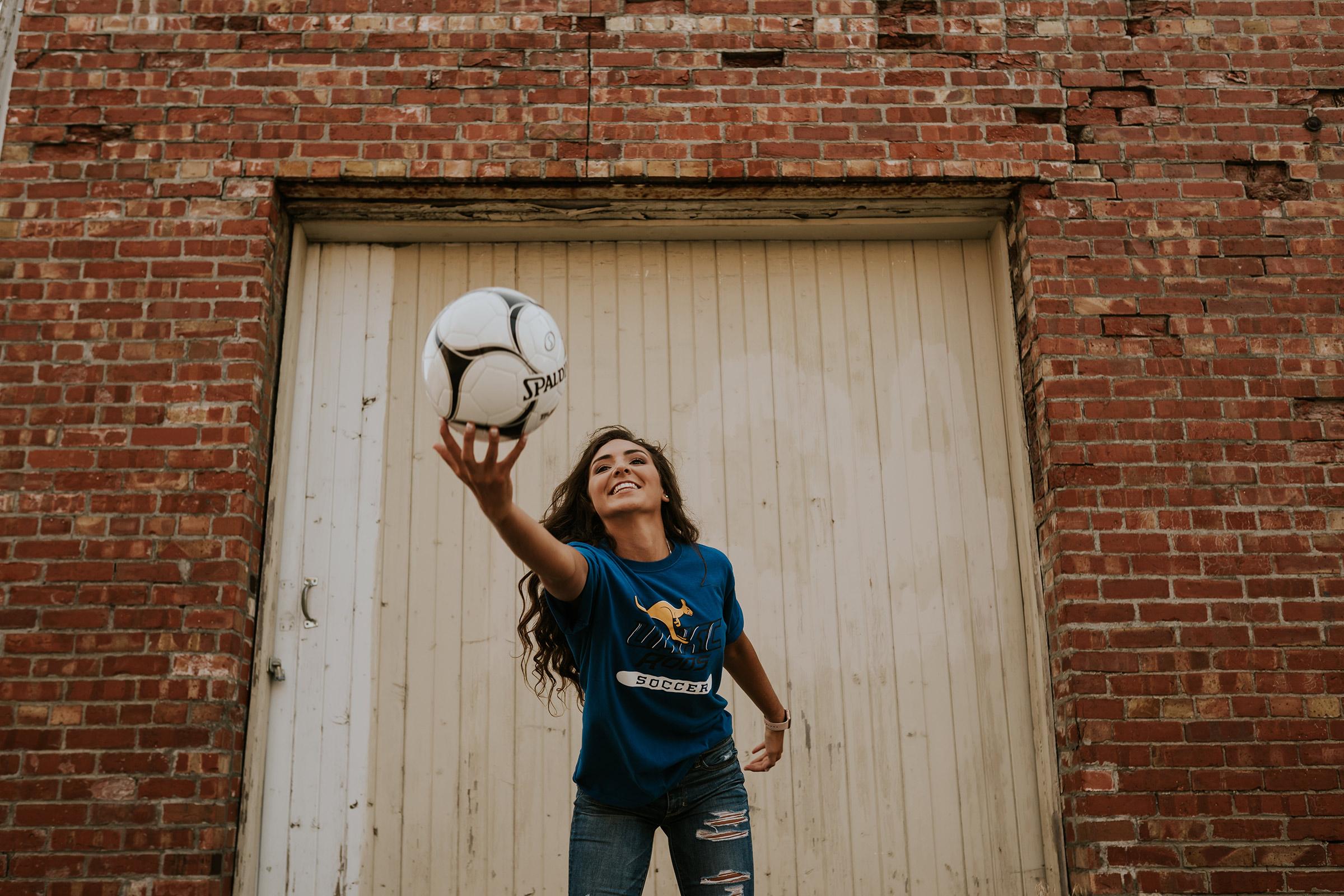 lizzy-senior-girl-catching-soccor-ball-ankeny-high-school-desmoines-iowa-raelyn-ramey-photography-61.jpg
