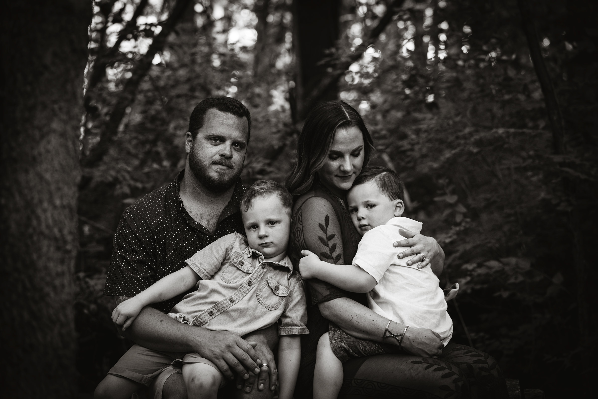 flynn-family-serious-black-and-white-jester-park-iowa-raelyn-ramey-photography.jpg