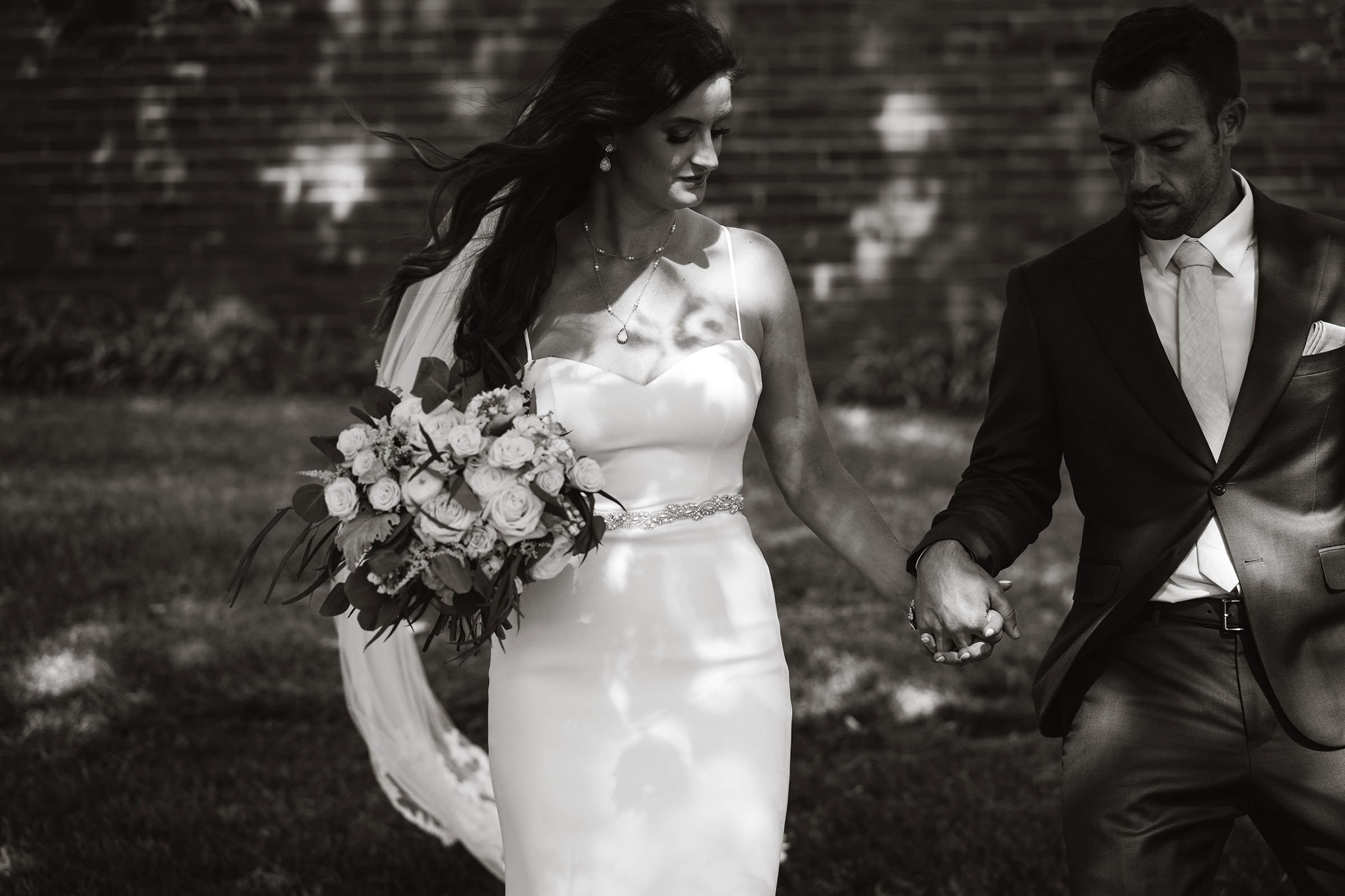 mr-mrs-hull-bride-and-groom-walking-holding-hands-desmoines-iowa-raelyn-ramey-photography-443.jpg