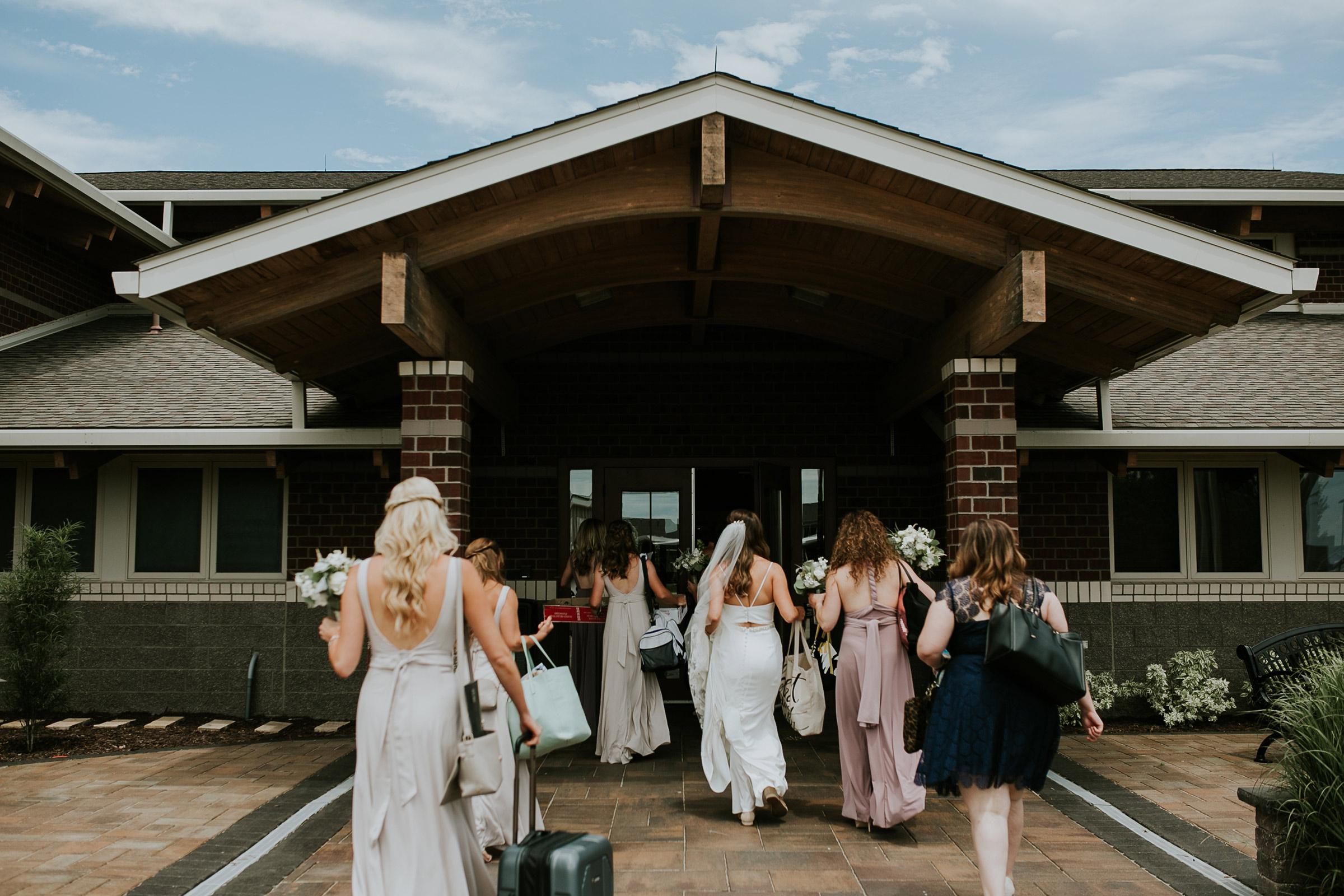 mr-mrs-hull-bride-bridesmaids-walking-into-st-boniface-church-waukee-desmoines-iowa-raelyn-ramey-photography-179.jpg