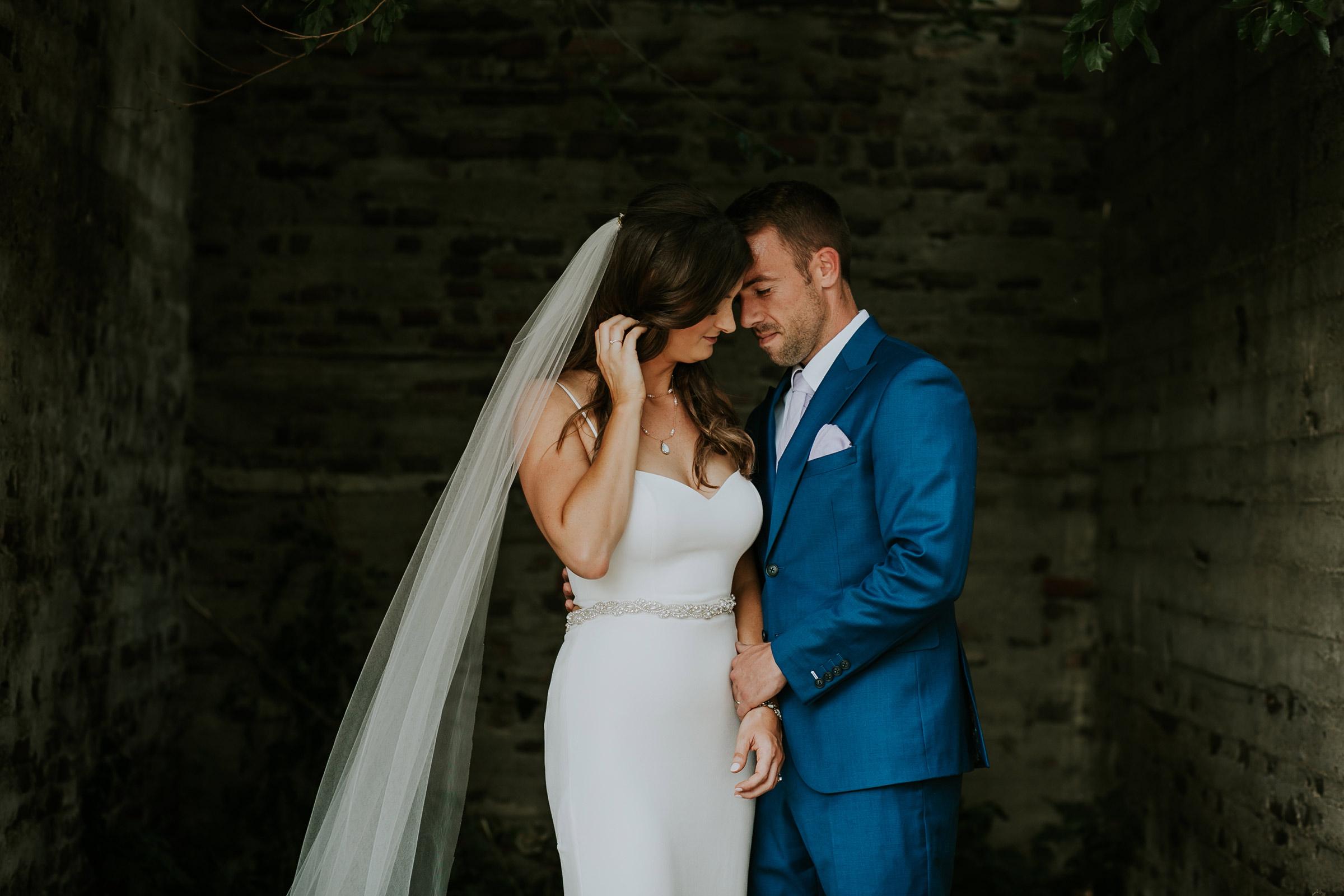 mr-mrs-hull-bride-groom-close-touching-desmoines-iowa-raelyn-ramey-photography-445.jpg
