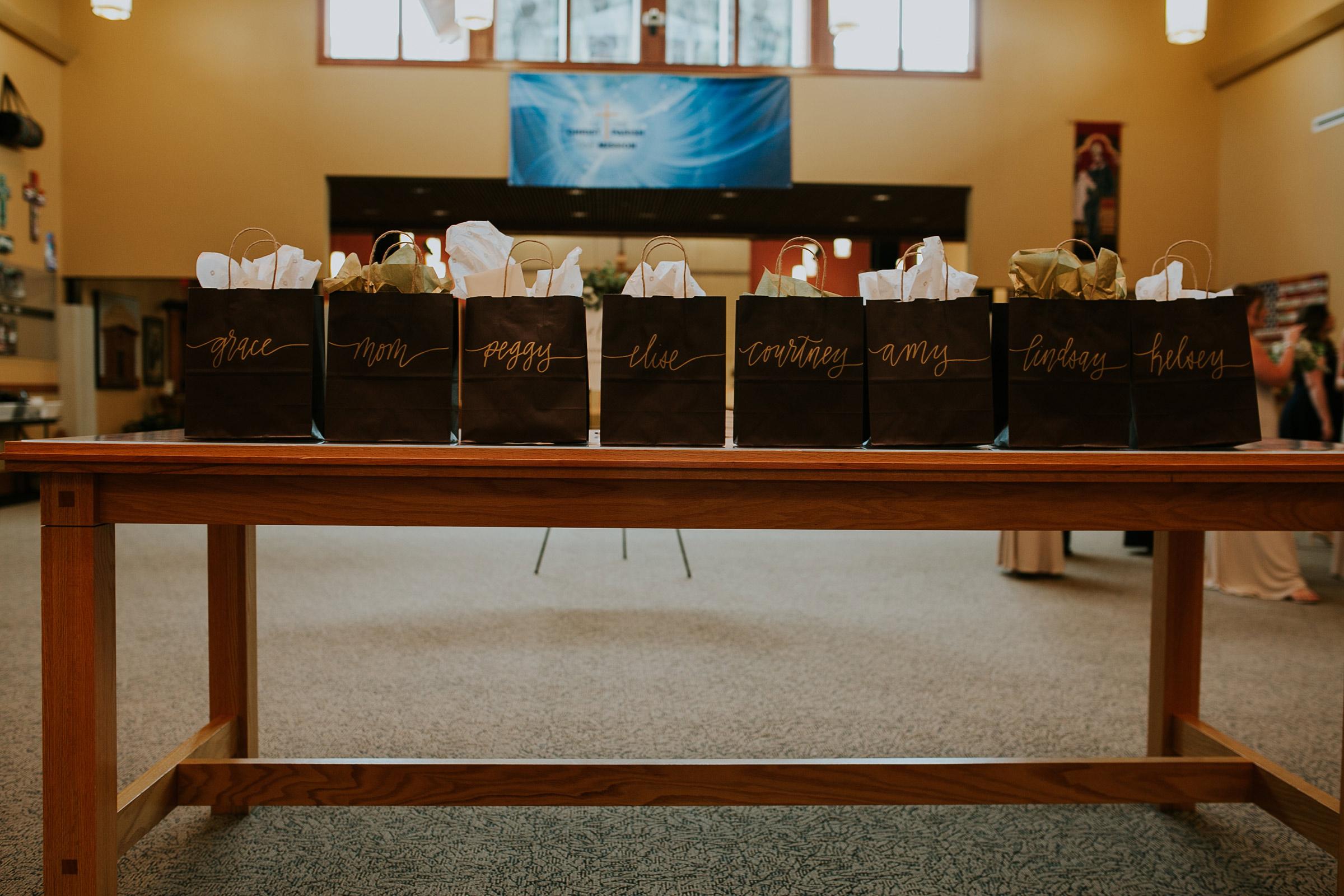 mr-mrs-hull-bride-giftbags-for-bridesmaids-st-boniface-church-waukee-desmoines-iowa-raelyn-ramey-photography-187.jpg