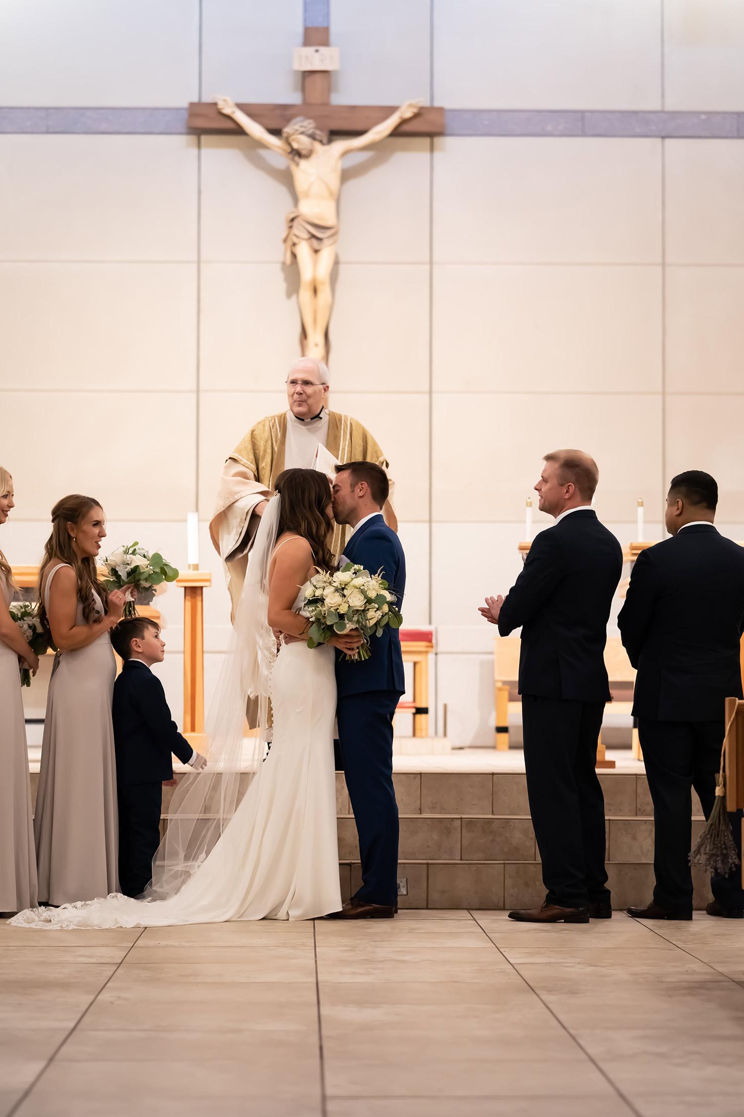 mr-mrs-hull-bride-groom-kissing-st-boniface-church-waukee-desmoines-iowa-raelyn-ramey-photography-347.jpg