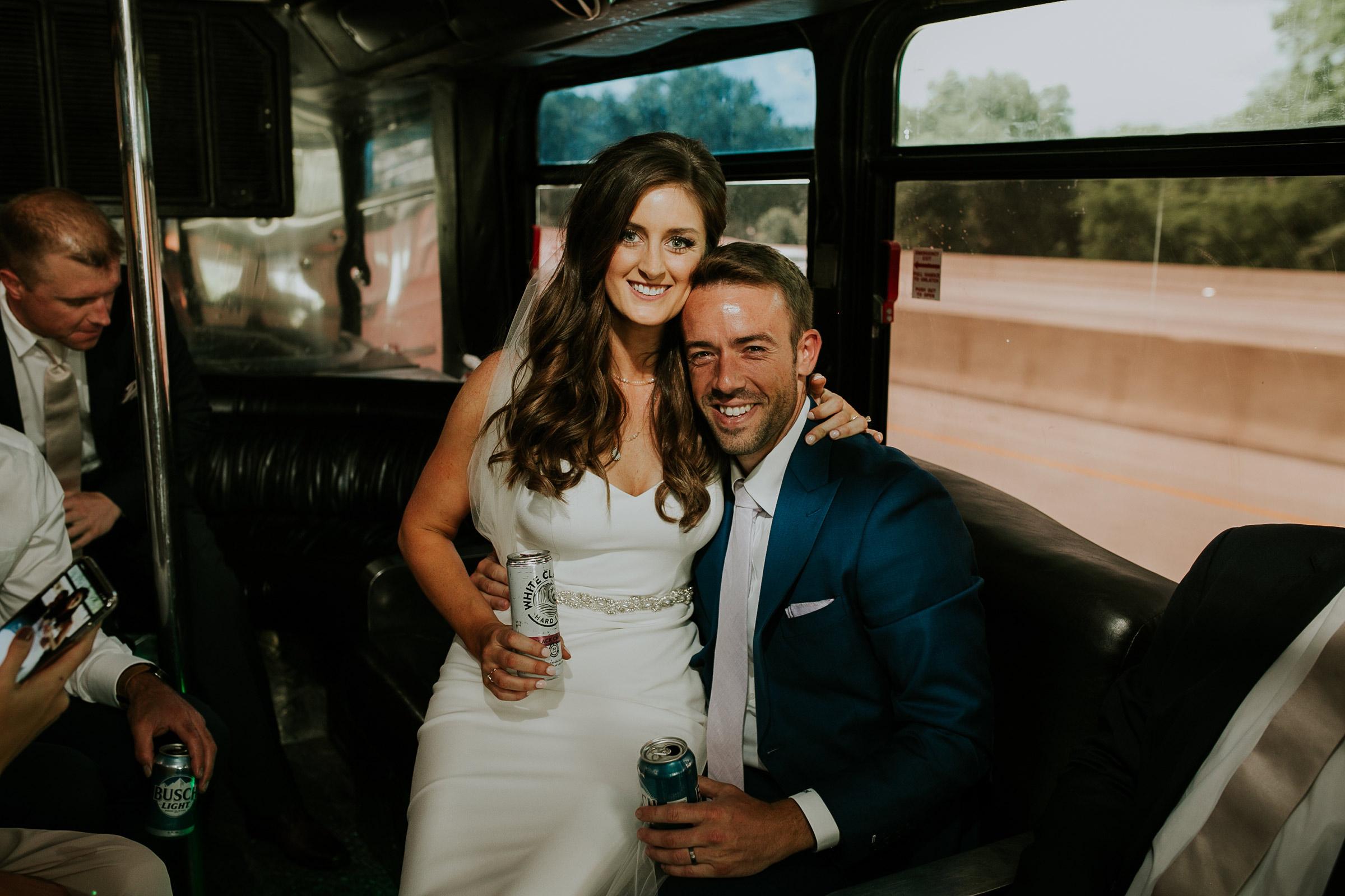 mr-mrs-hull-bride-groom-smile-bus-desmoines-iowa-raelyn-ramey-photography-390.jpg