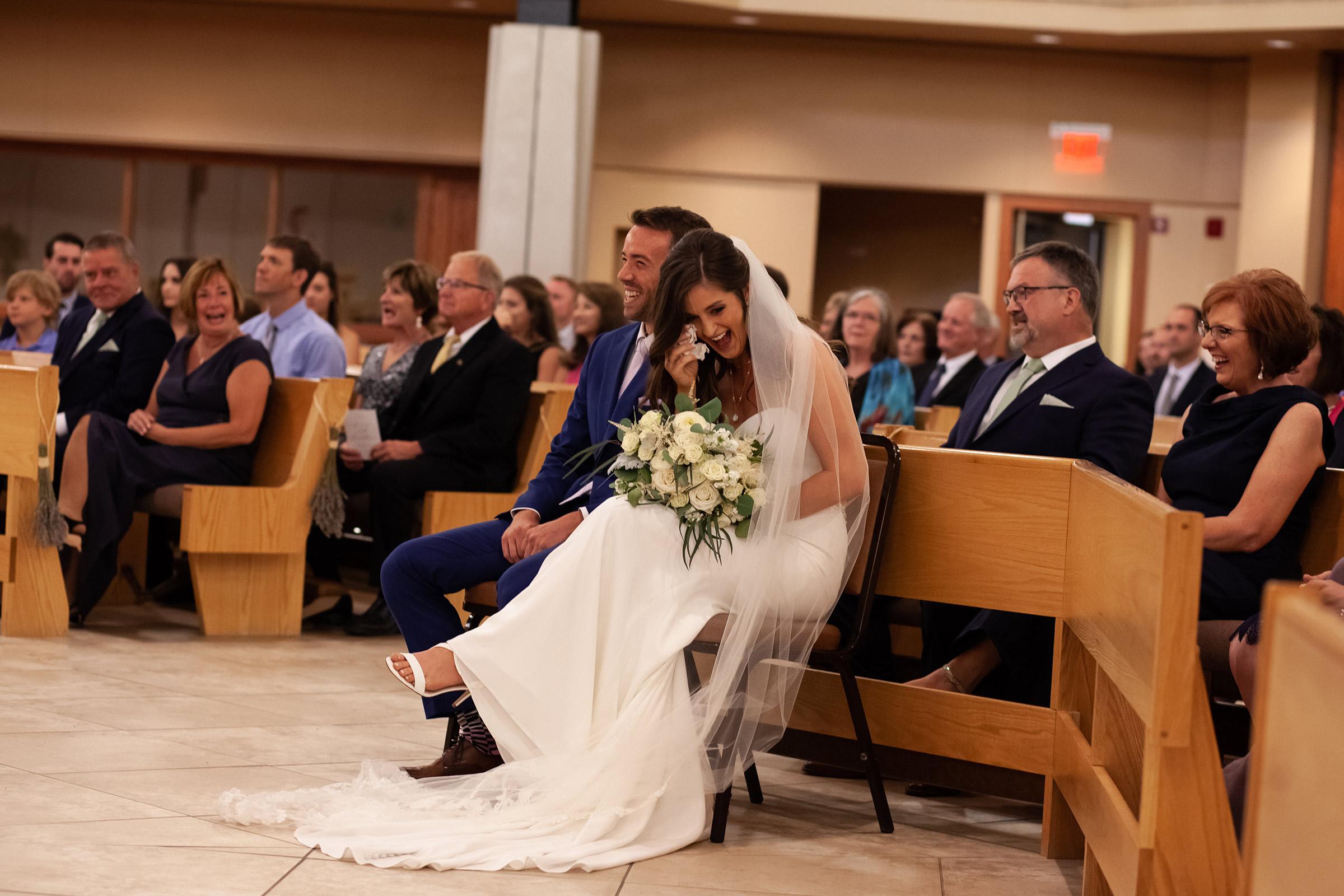 mr-mrs-hull-bride-groom-laughing-ceremony-st-boniface-church-waukee-desmoines-iowa-raelyn-ramey-photography-328.jpg