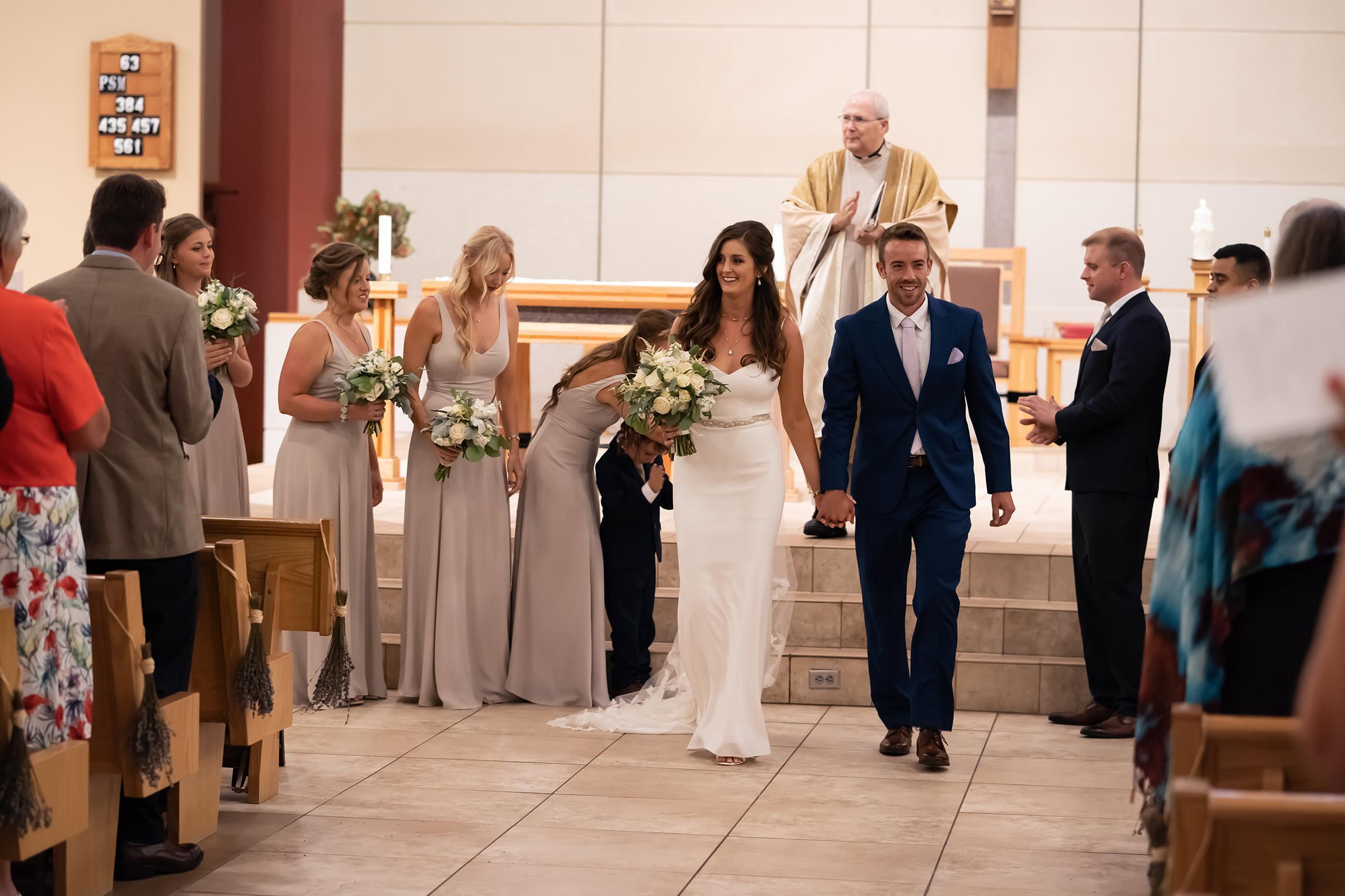 mr-mrs-hull-bride-groom-walking-down-aisle-desmoines-iowa-raelyn-ramey-photography-348.jpg