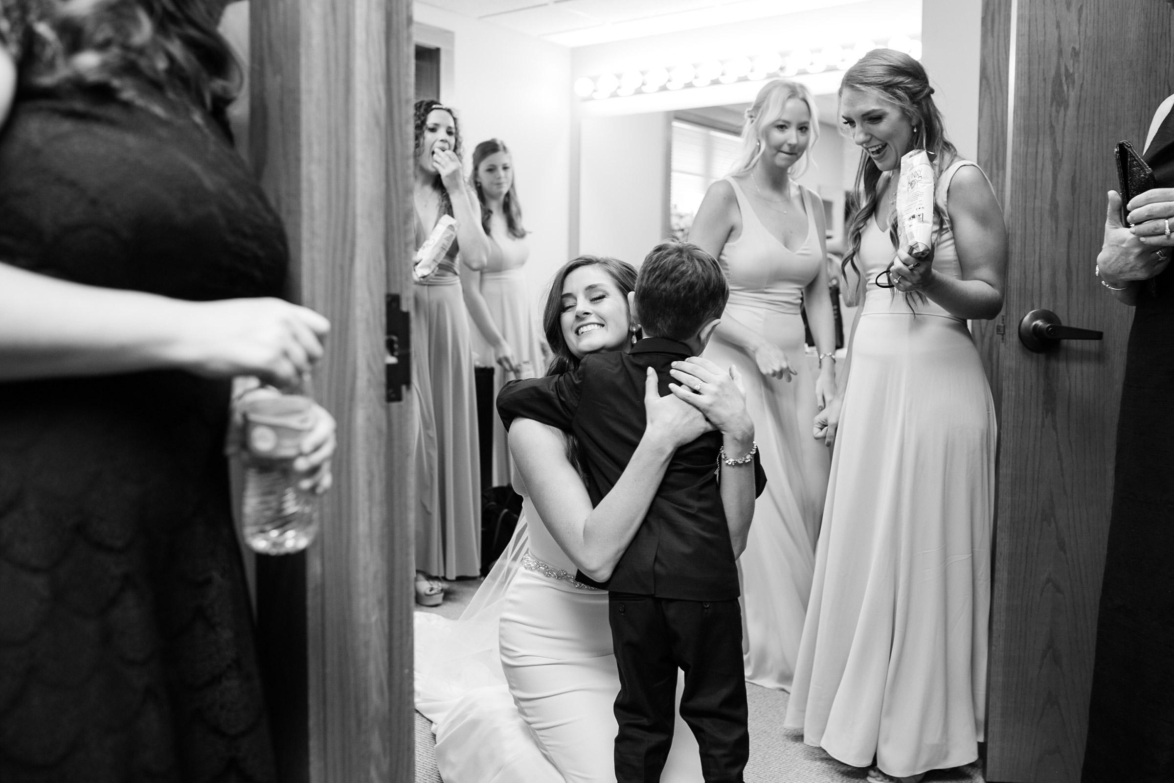 mr-mrs-hull-bride-hugging-ring-bearer-desmoines-iowa-raelyn-ramey-photography-282.jpg