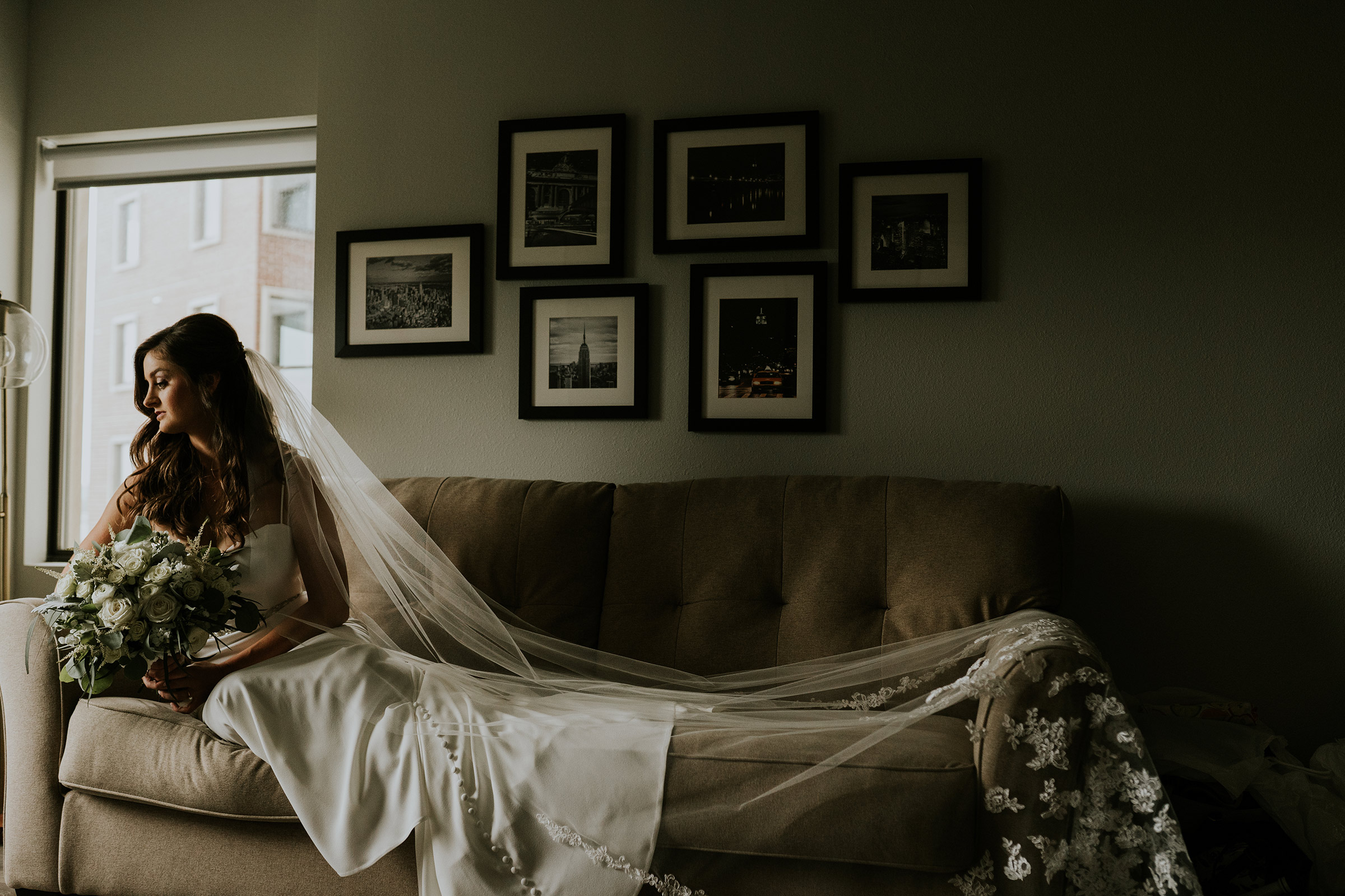 mr-mrs-hull-bride-posing-on-couch-desmoines-iowa-raelyn-ramey-photography-81.jpg