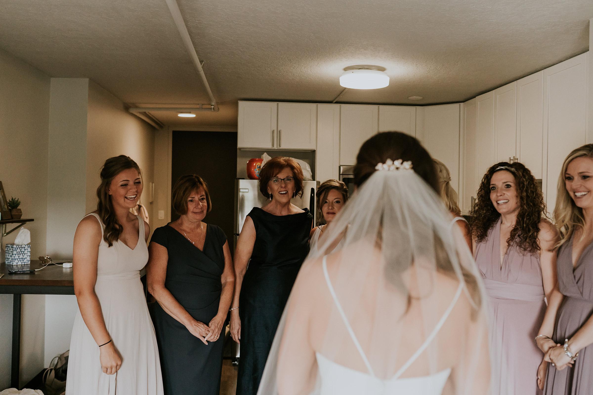 mr-mrs-hull-bride-showing-off-dress-desmoines-iowa-raelyn-ramey-photography-71.jpg